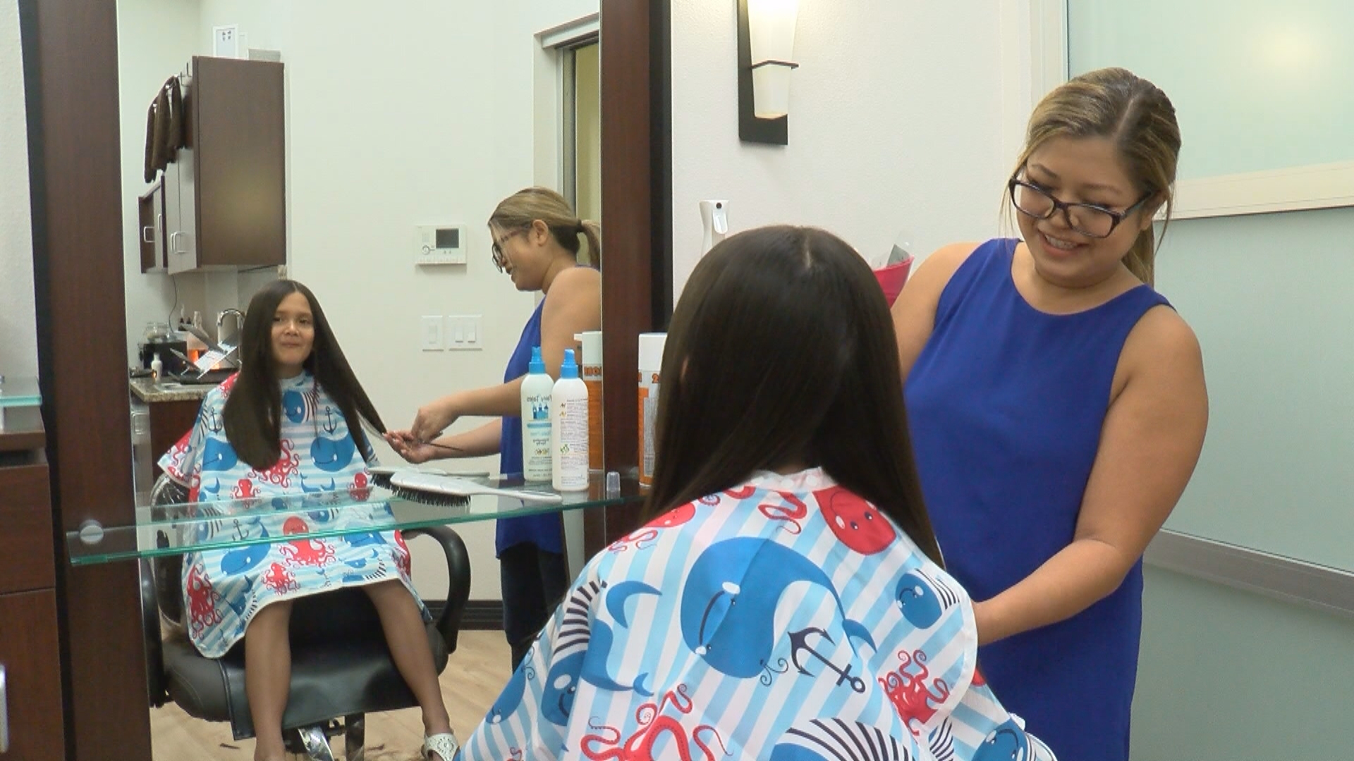 Students receive a free back-to-school haircut, with a school supply donation, on Sunday, August 13, 2017, at My Salon Suite in Las Vegas. (Chad Graves/KSNV)