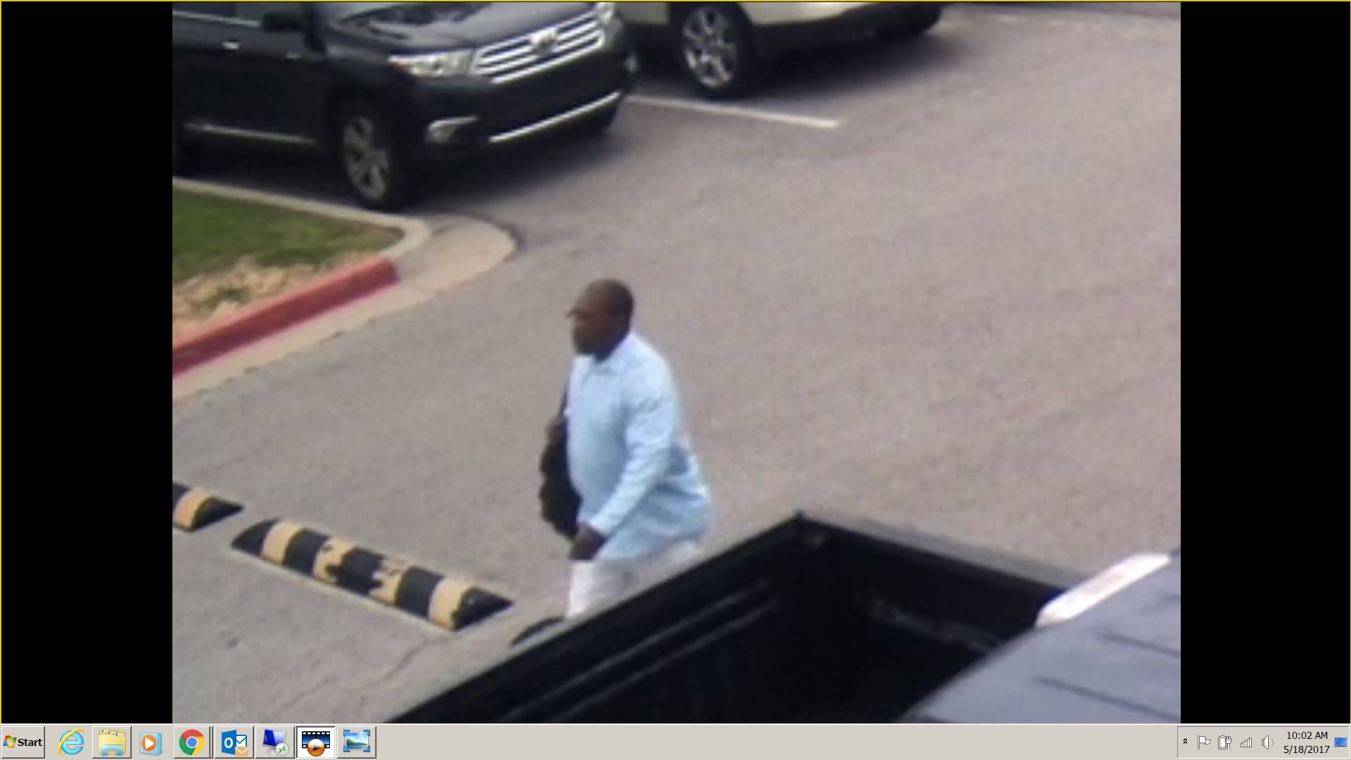 Surveillance video shows a man that police say burglarized a vehicle May 16 at Bishop McGuinness High School. (Oklahoma City Police Department)