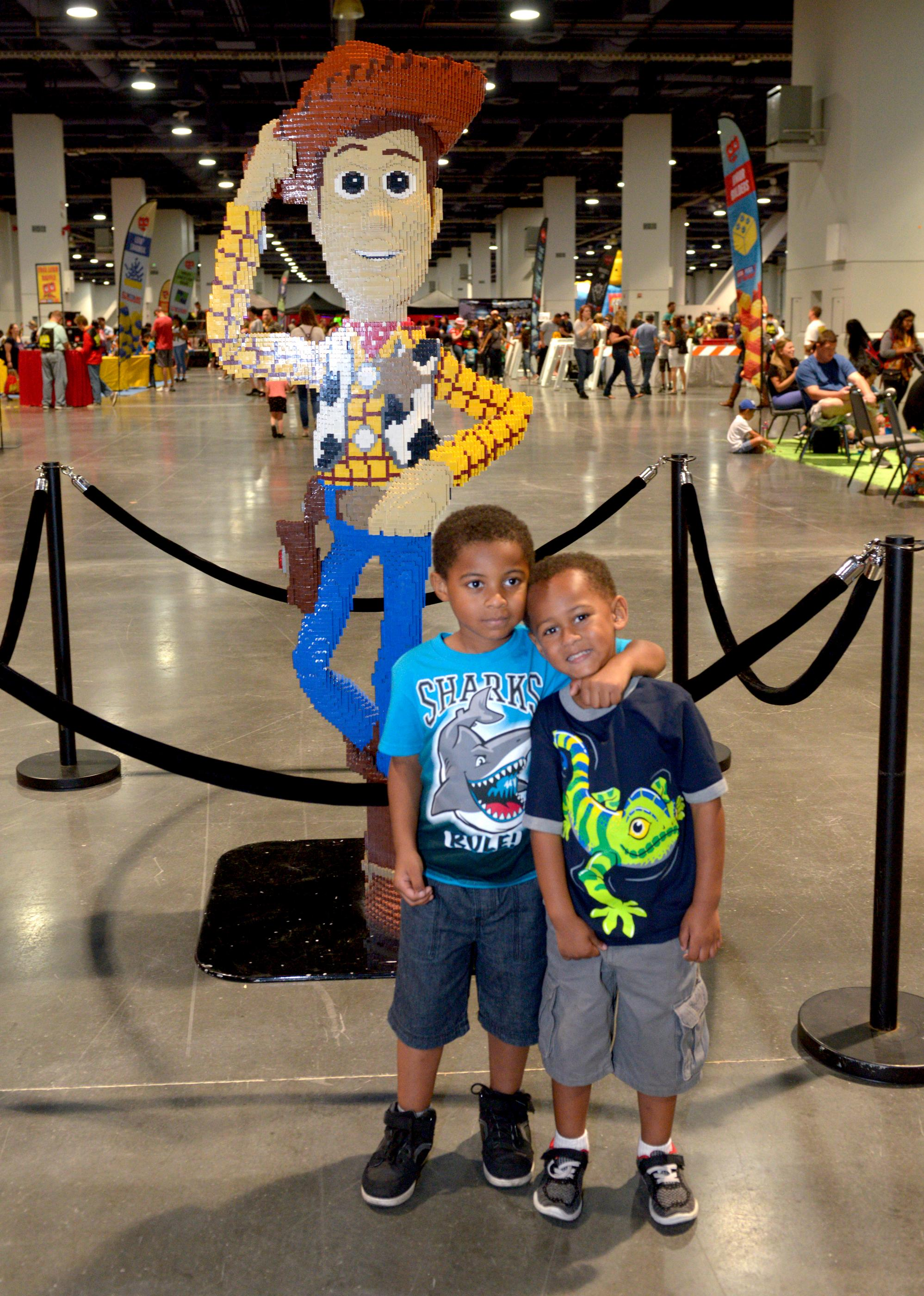 Buddies pose with a statue of Toy Stories Woody made completely out of Legos during the Brick Fest Live Lego Fan Experience at the Las Vegas Convention Center, September 9, 2017. [Glenn Pinkerton/Las Vegas News Bureau]