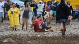 The Latest: Muddy day at Pimlico for race fans, horses