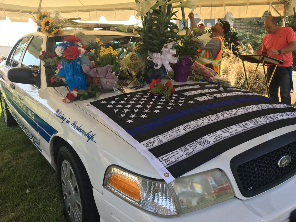 On Friday, Master Patrol Officer Jason Harris' squad car was on display as a memorial.  A blood drive was also held in his honor.  (Photo credit: WLOS Staff)
