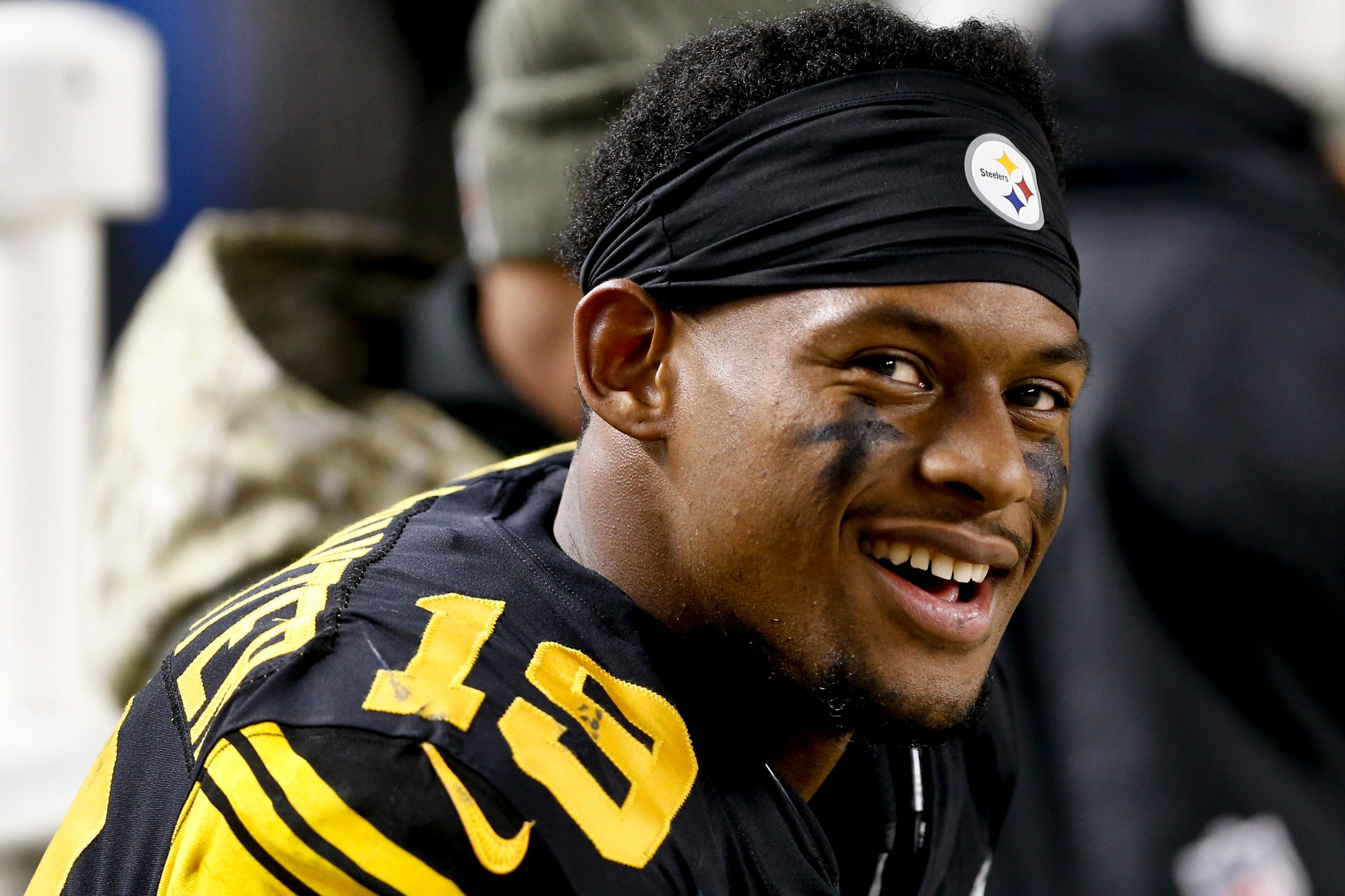 FILE - In this Nov. 16, 2017, file photo, Pittsburgh Steelers wide receiver JuJu Smith-Schuster (19) smiles on he sideline during an NFL football game against the Tennessee Titans, in Pittsburgh. Smith-Schuster has been suspended one game by the NFL for violating league safety rules. Smith-Schuster was flagged for unnecessary roughness and taunting after a blindside hit on Bengals linebacker Vontaze Burfict in the fourth quarter of Pittsburgh's 23-20 victory Monday night, Dec. 5. (AP Photo/Keith Srakocic, File)<p></p>
