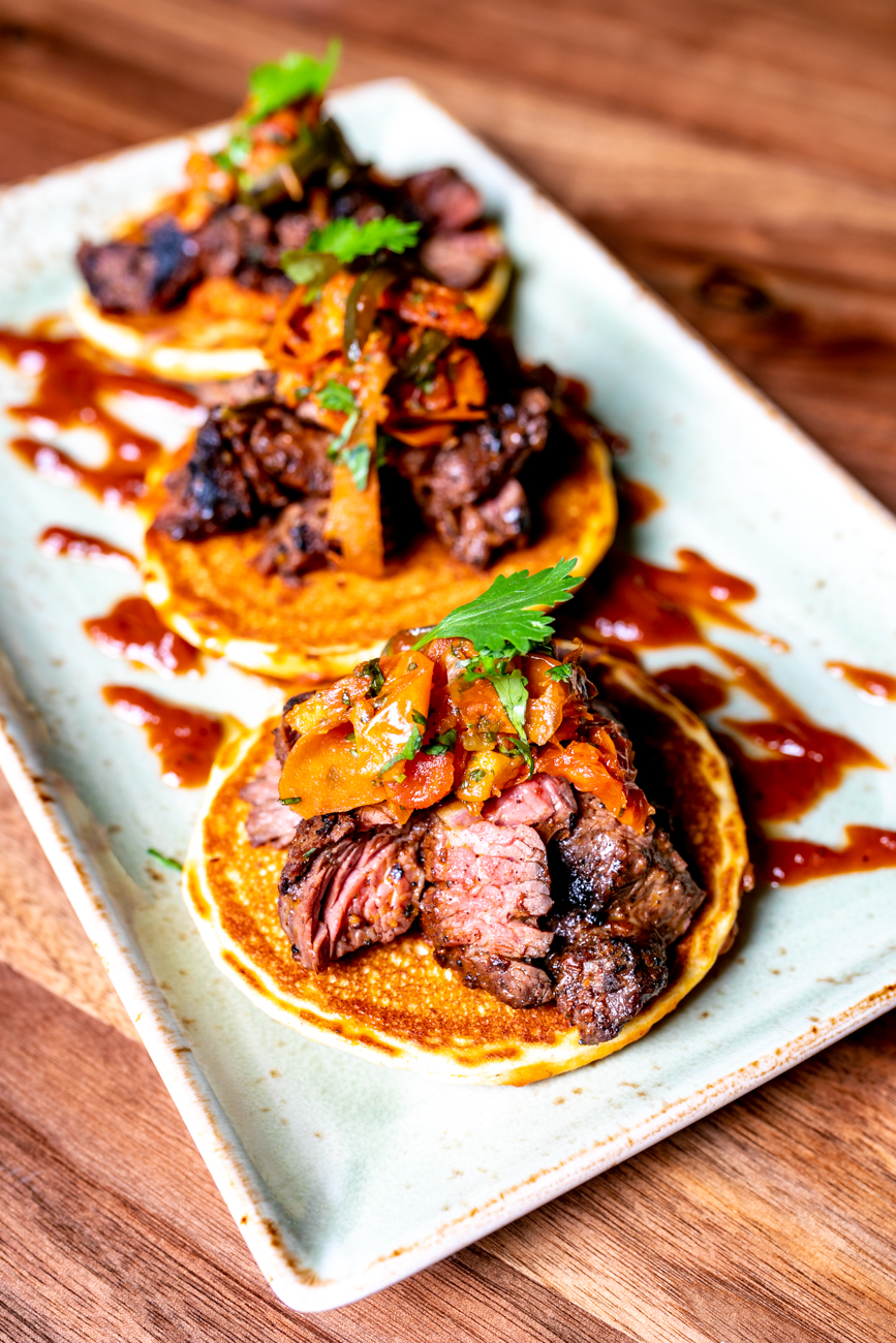 Steak & Hoe Cakes: poblano tomato sauce and roasted tomato jalapeno salsa / Image: Amy Elisabeth Spasoff // Published: 9.23.18