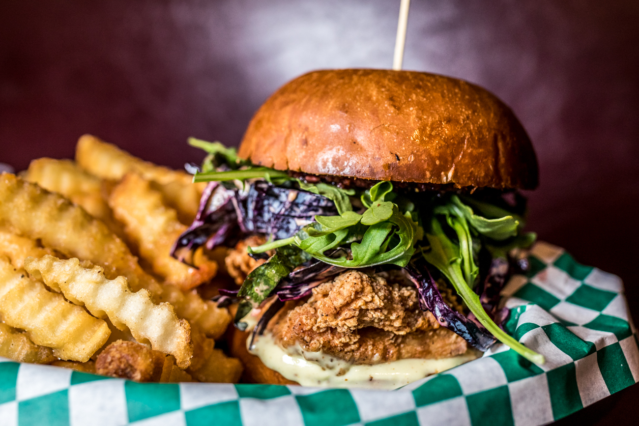 Chamwich: boneless chicken topped with sweet kimchi, cham slaw, greens, and lemon aioli in a challah bun and served with fries / Image: Catherine Viox{ }// Published: 12.26.19