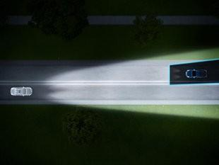 Volvo's Active High Beam Control uses a light matched to a computer-controlled blind that shields your headlight beam from an oncoming driver's eye. Federal vehicle safety code permits only one kind of low beam, the kind that dims all high beams.