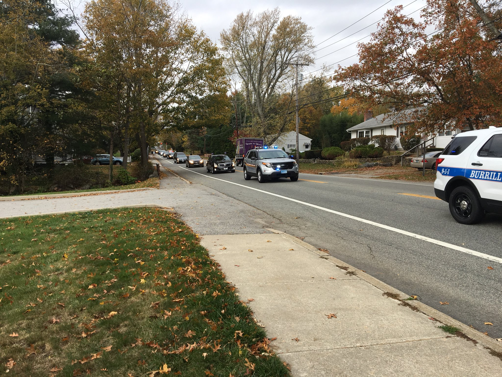 The funeral procession for Gianna Cierra passes the East Greenwich Police Department, where Gianna's father is deputy chief. (WJAR)