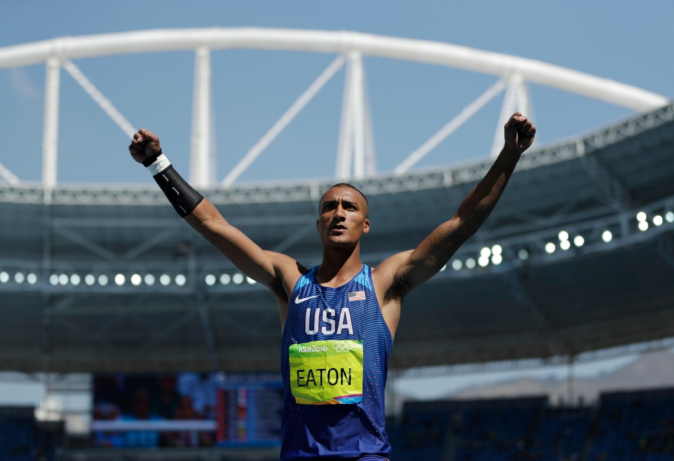 United States' Ashton Eaton celebrates after an attempt in the shot put of the decathlon during the athletics competitions of the 2016 Summer Olympics at the Olympic stadium in Rio de Janeiro, Brazil, Wednesday, Aug. 17, 2016. (AP Photo/Matt Slocum)