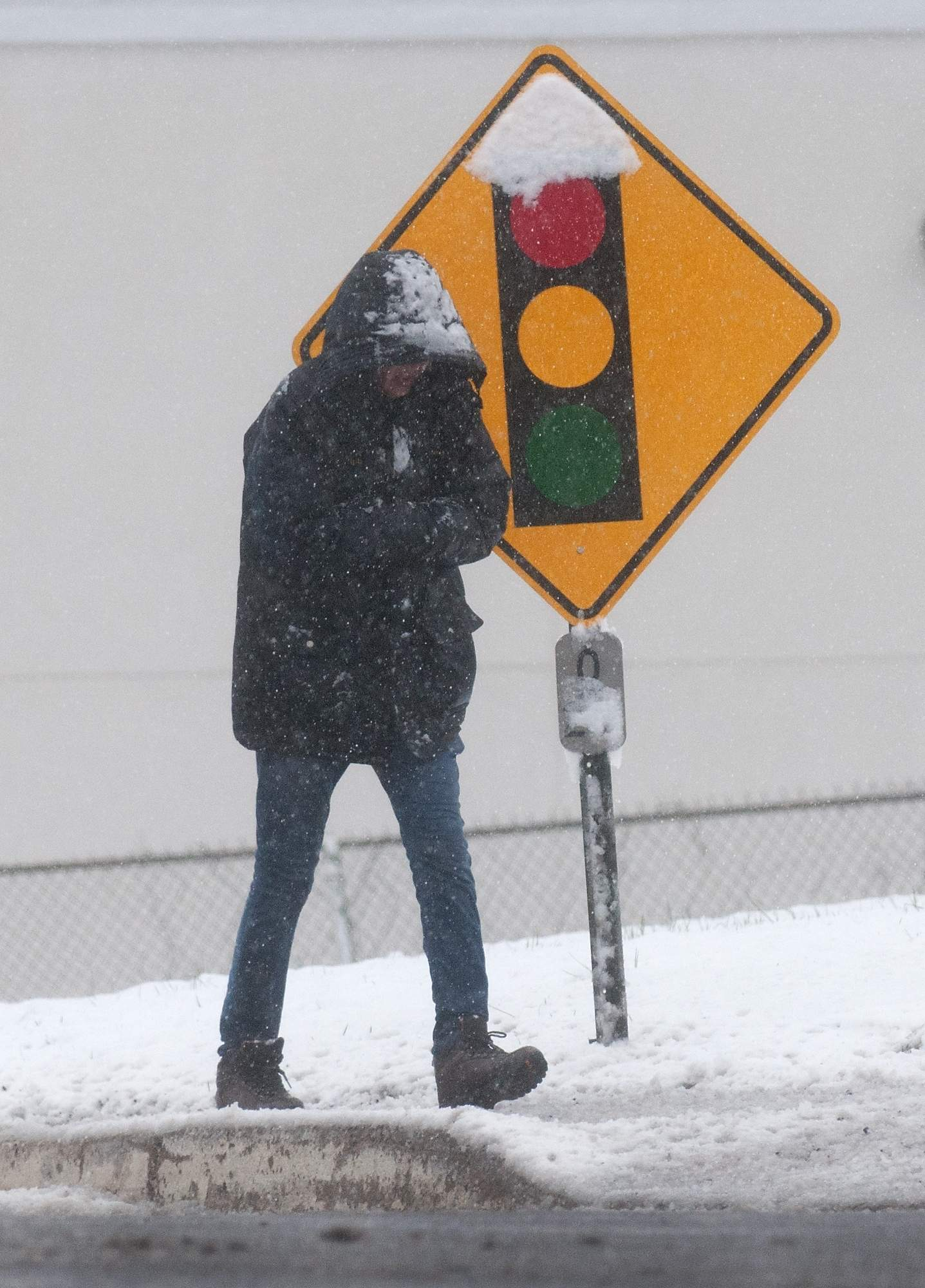 A pedestrian makes their way along Bustleton Pike during a second nor'easter Wednesday, March 7, 2018 in Lower Southampton. [BILL FRASER / STAFF PHOTOJOURNALIST]