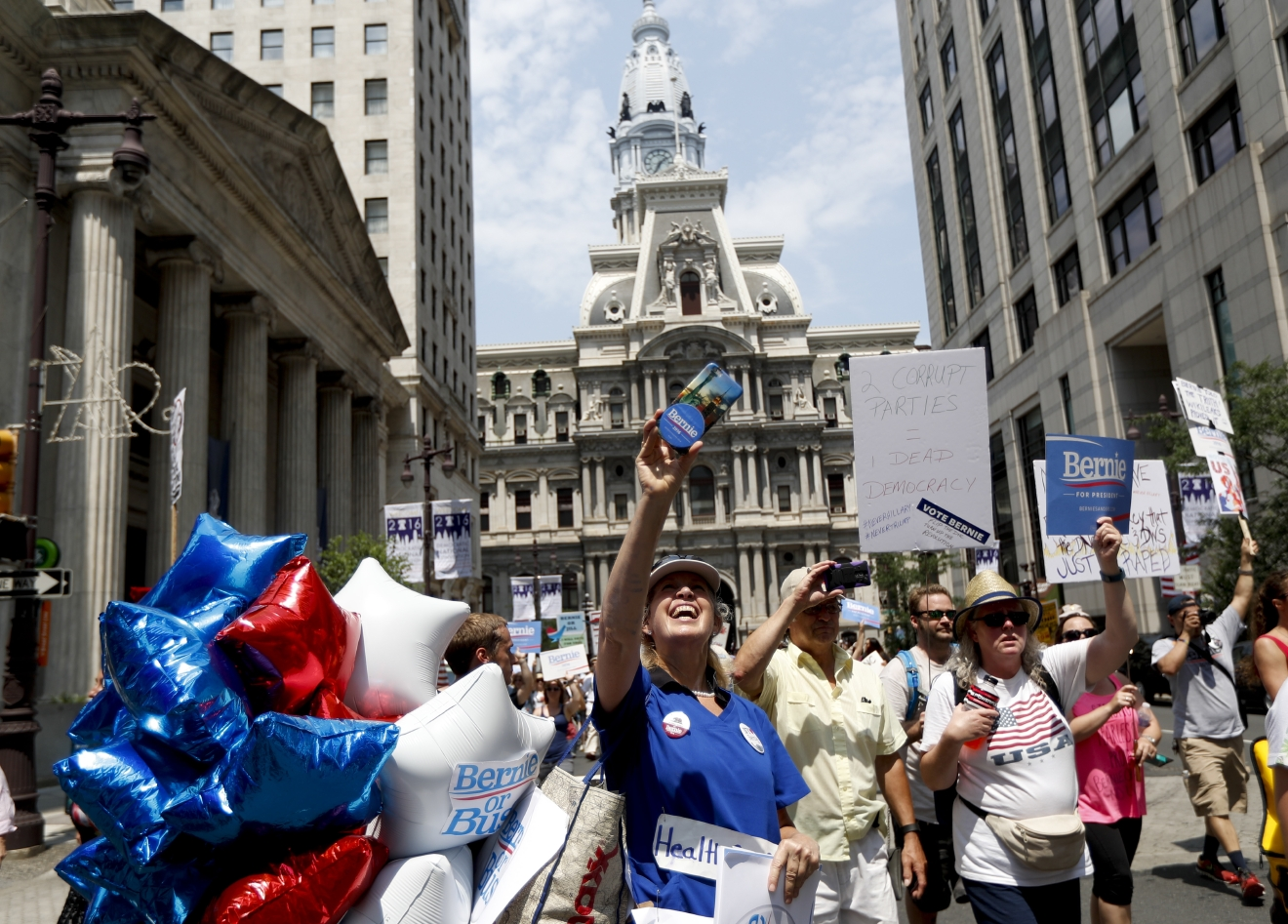 Demonstrators make their way around downtown, Monday, July 25, 2016, in Philadelphia, during the first day of the Democratic National Convention. (AP Photo/John Minchillo)