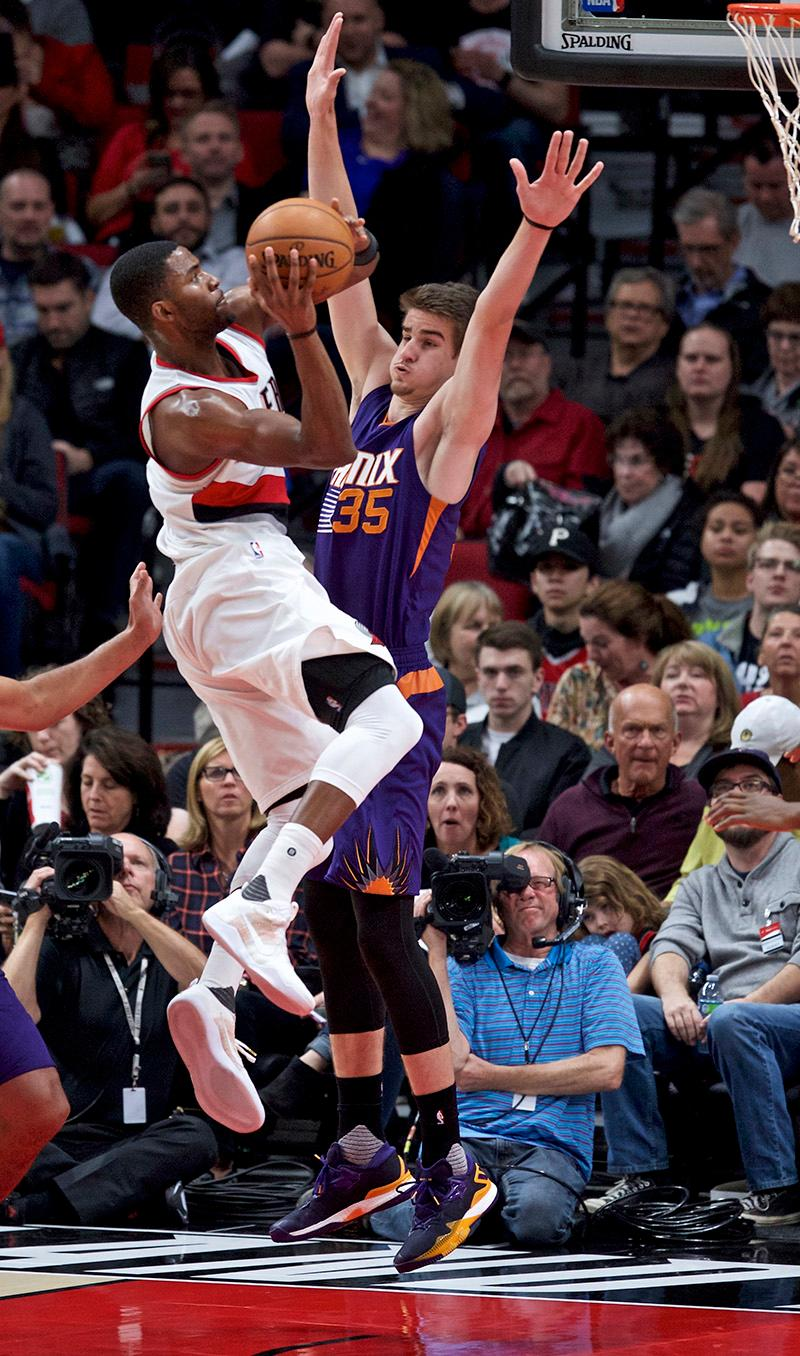 Portland Trail Blazers forward Maurice Harkless goes to the basket as Phoenix Suns forward Dragan Bender defends during the second half of an NBA basketball game in Portland, Ore., Tuesday, Nov. 8, 2016. (AP Photo/Craig Mitchelldyer)