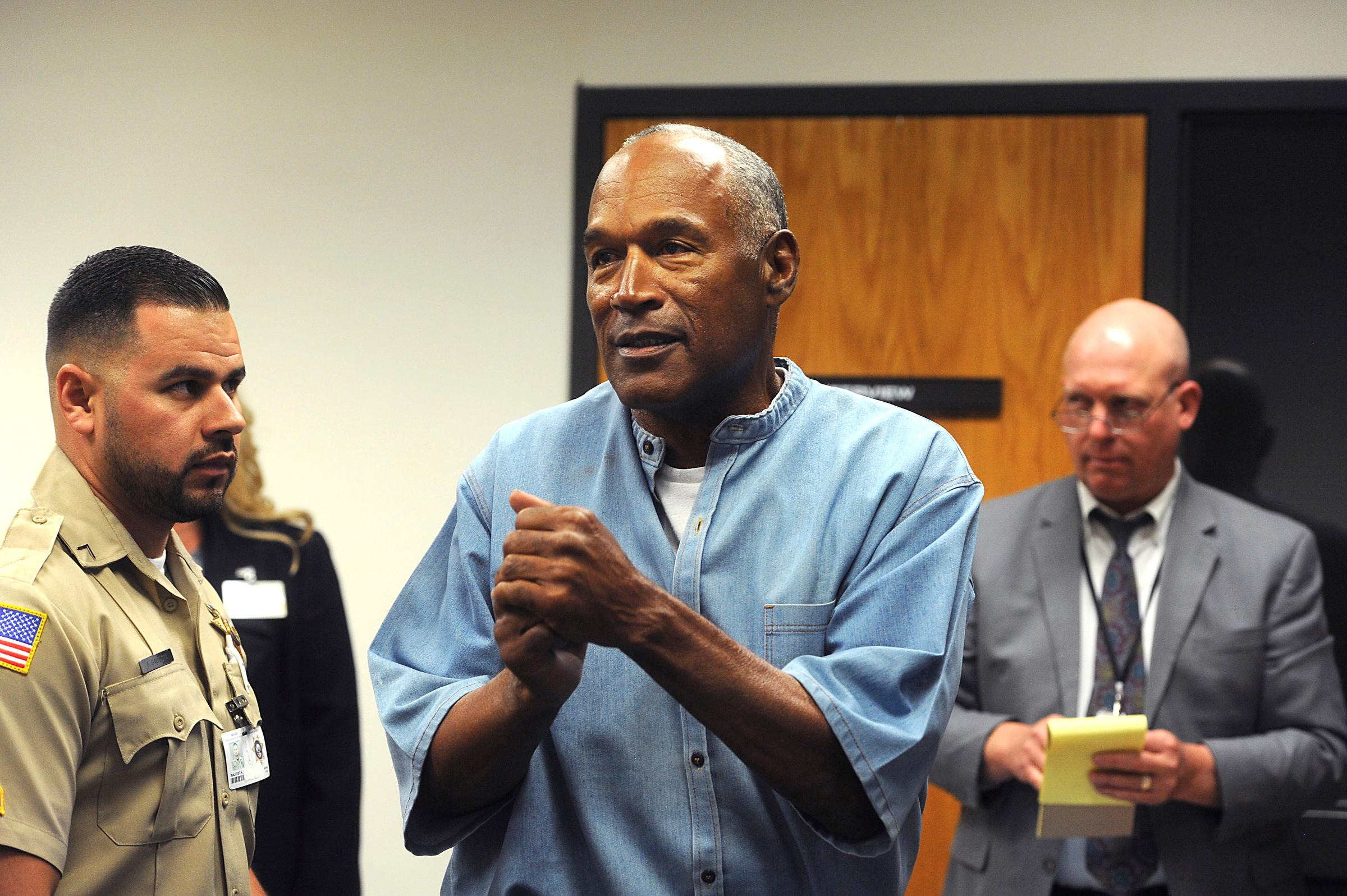 Former NFL football star O.J. Simpson reacts after learning he was granted parole at Lovelock Correctional Center in Lovelock, Nev., on Thursday, July 20, 2017.  Simpson was convicted in 2008 of enlisting some men he barely knew, including two who had guns, to retrieve from two sports collectibles sellers some items that Simpson said were stolen from him a decade earlier.   (Jason Bean/The Reno Gazette-Journal via AP, Pool)