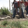 Youth group battles heat while building houses