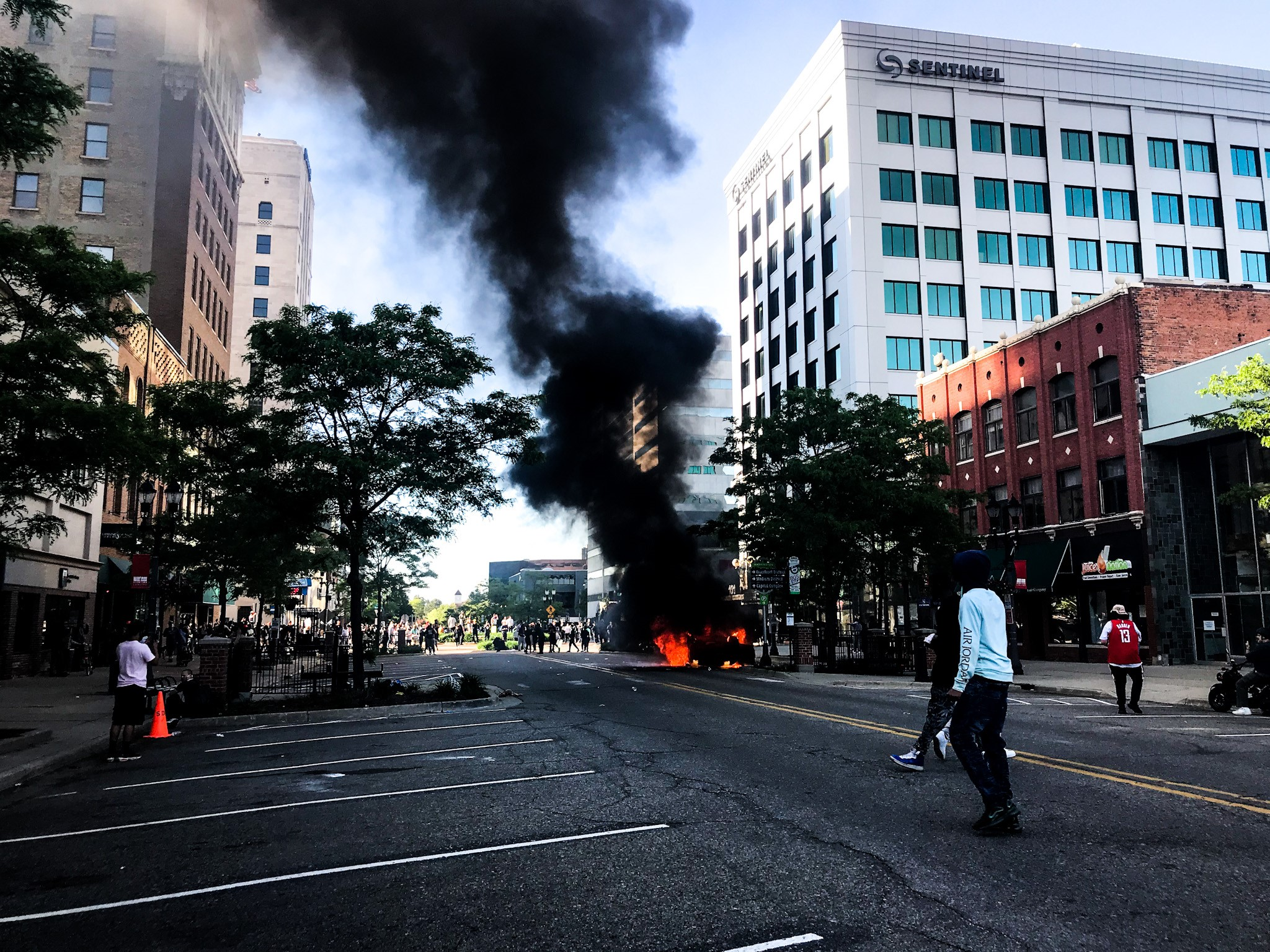A car was completely burned on a street in Lansing after a peaceful protest turned violent on Sunday, May 31, 2020. (WWMT/Mikenzie Frost)<p></p>
