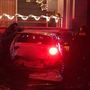 Firefighters free driver trapped after car hits house in U-District