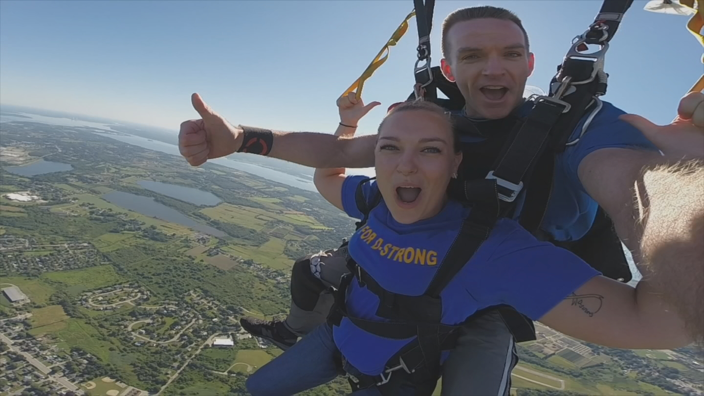 Melissa Murray jumped from 10,000 feet at Skydive Newport, which donated $50 per jumper to Dorian Murray Foundation. (WJAR)