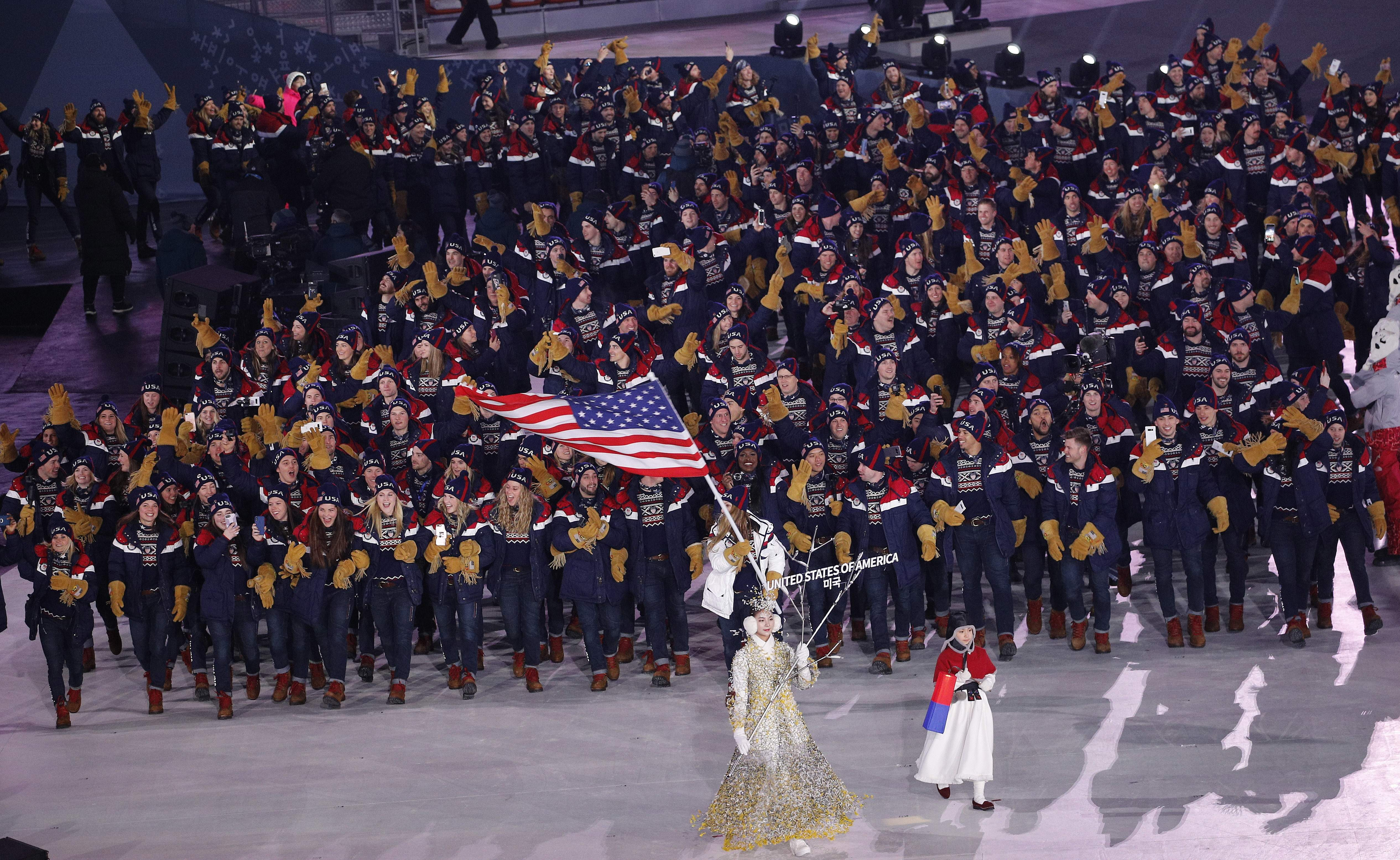 Erin Hamlin carries the flag of the United States during the opening ceremony of the 2018 Winter Olympics in Pyeongchang, South Korea, Friday, Feb. 9, 2018. (AP Photo/Christophe Ena)