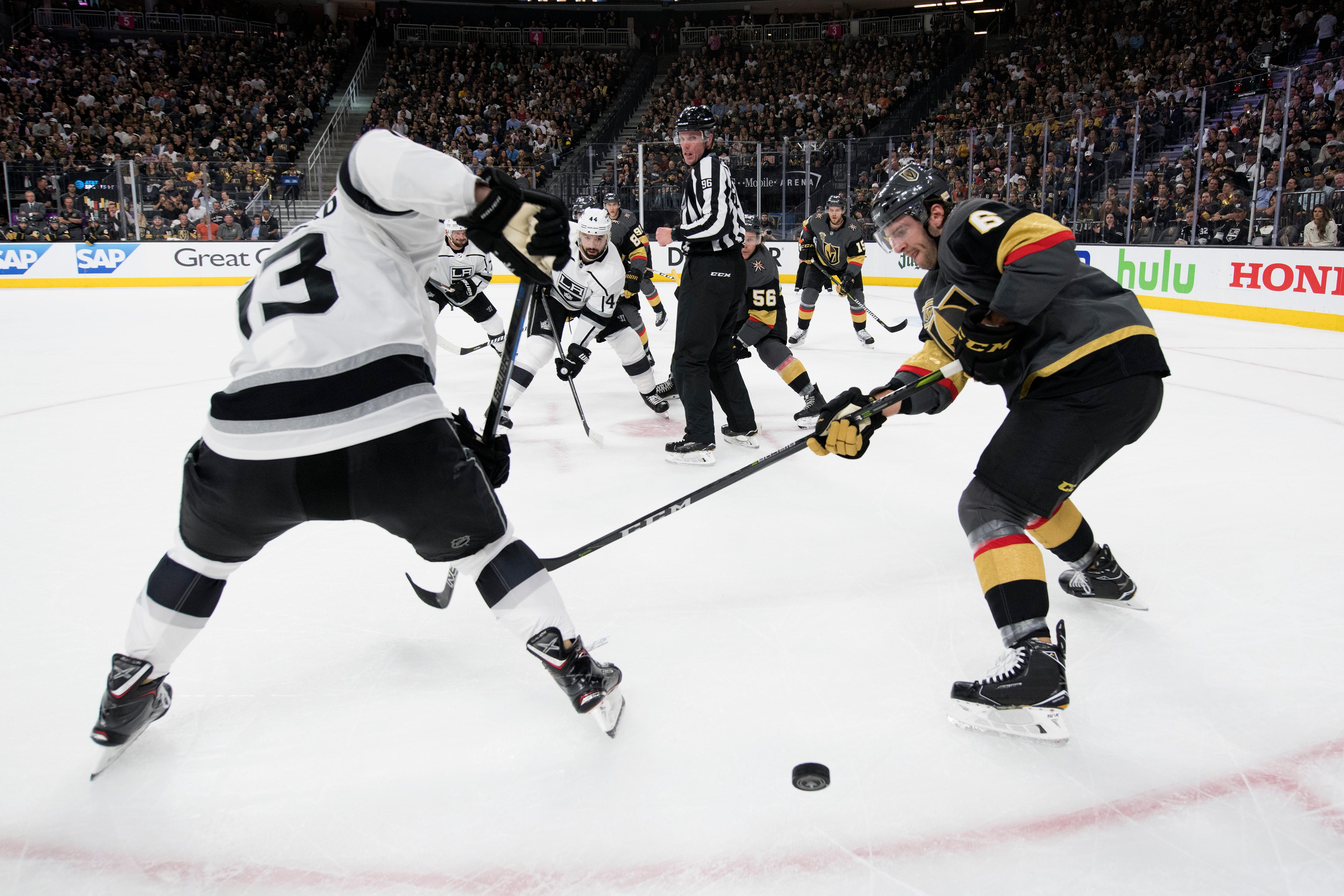 Los Angeles Kings left wing Kyle Clifford (13) and Vegas Golden Knights defenseman Colin Miller (6) vie for a face-off puck during the first period of Game 1 of their NHL hockey first-round playoff series Wednesday, April 11, 2018 at T-Mobile Arena. The Knights won 1-0. CREDIT: Sam Morris/Las Vegas News Bureau