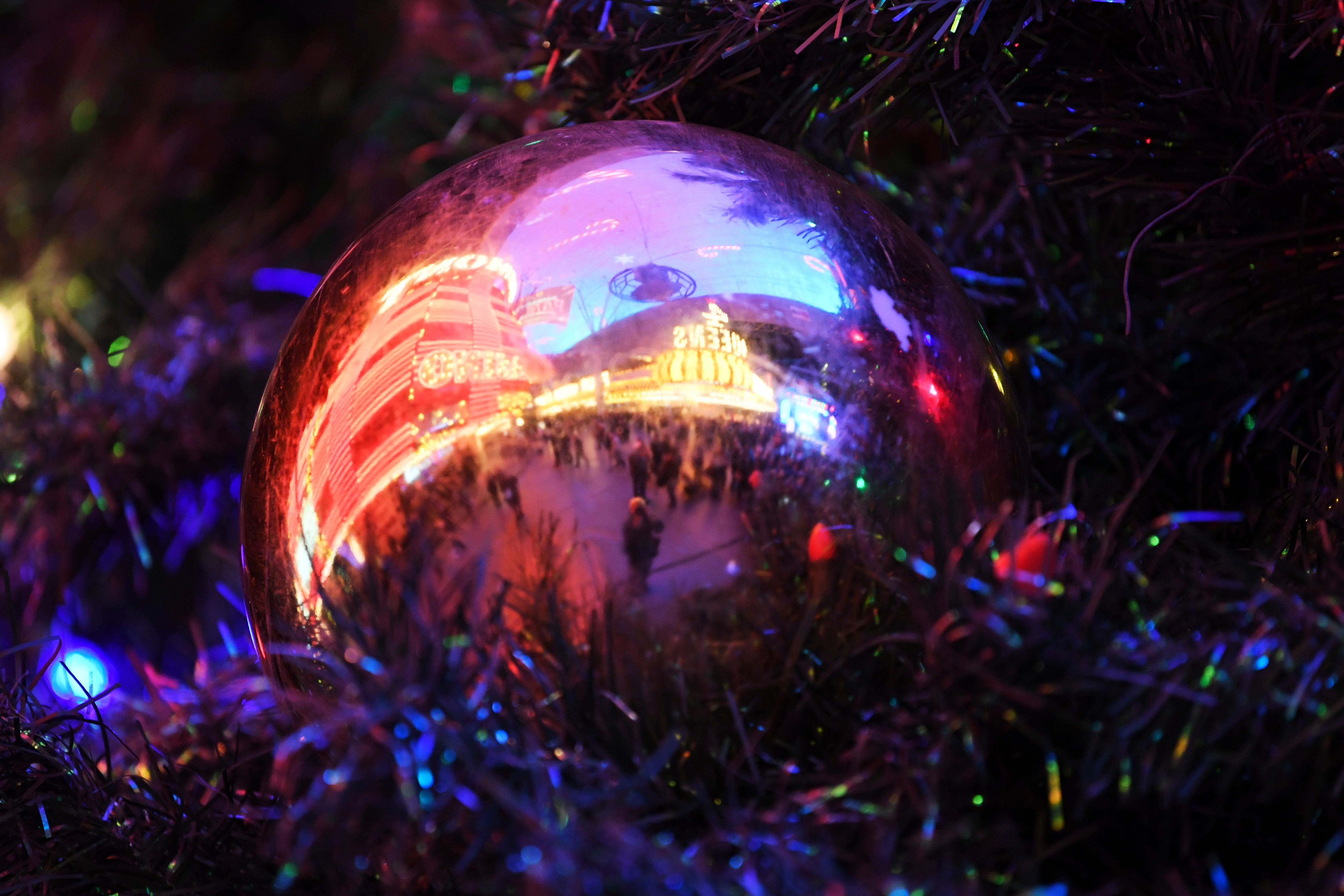An ornament reflects the lights of the Fremont Street Experience during the annual lighting of a Christmas tree Tuesday, December 4, 2018. CREDIT: Sam Morris/Las Vegas News Bureau