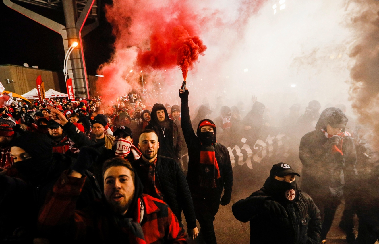 Toronto FC fans walk to a match before Toronto plays the Seattle Sounders in MLS Cup soccer game final action in Toronto, Saturday, Dec. 10, 2016. (Mark Blinch/The Canadian Press via AP)