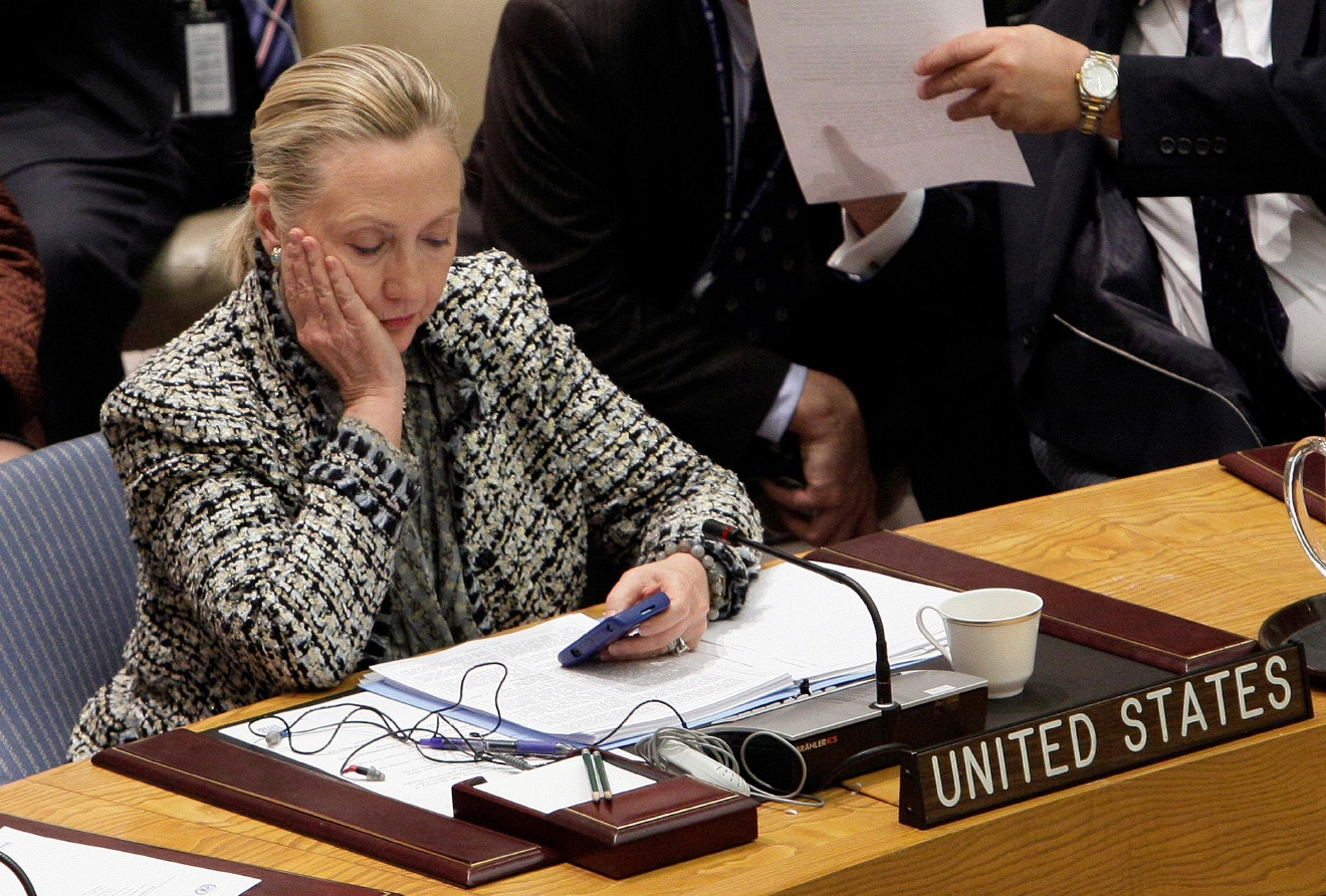 FILE - In this March 12, 2012 file photo, then-Secretary of State Hillary Rodham Clinton checks her mobile phone after her address to the Security Council at United Nations headquarters. An impromptu meeting between Bill Clinton and the nation's top cop could further undermine Hillary Clinton�s efforts to convince voters to place their trust in her, highlighting perhaps her biggest vulnerability. (AP Photo/Richard Drew, File)