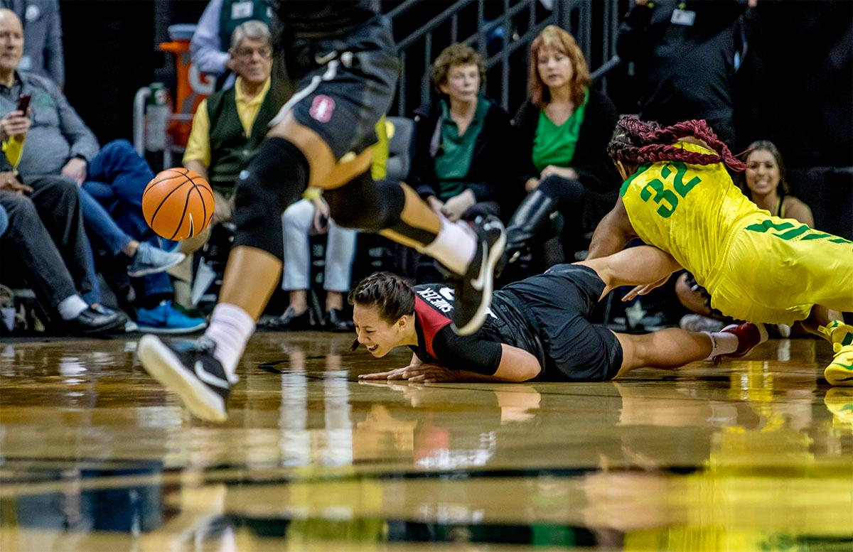 The Cardinal's Marta Sniezek (#13) loses the ball as she takes a tumble. The Stanford Cardinal defeated the Oregon Ducks 78-65 on Sunday afternoon at Matthew Knight Arena. Stanford is now 10-2 in conference play and with this loss the Ducks drop to 10-2. Leading the Stanford Cardinal was Brittany McPhee with 33 points, Alanna Smith with 14 points, and Kiana Williams with 14 points. For the Ducks Sabrina Ionescu led with 22 points, Ruthy Hebard added 16 points, and Satou Sabally put in 14 points. Photo by August Frank, Oregon News Lab