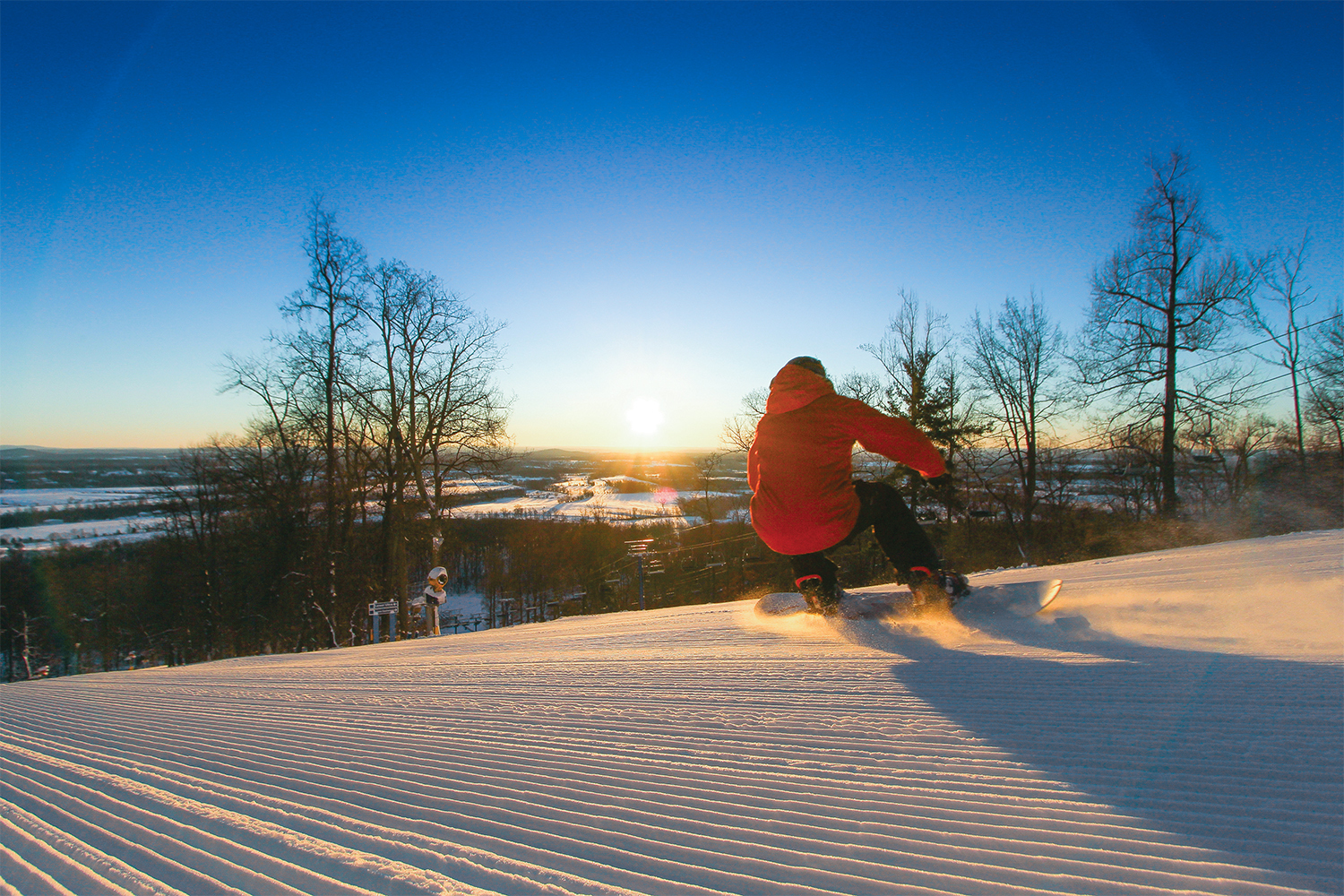 Snowboarder at sunset.