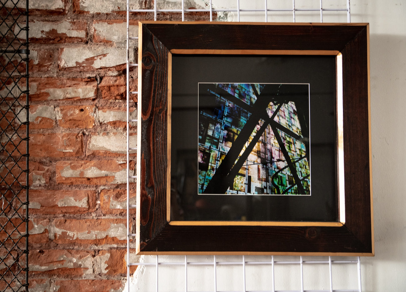 Ryan Hill with ImageNationS Photography is a Newport-based photographer who uses his carpentry skills to design and create his own unique framing. His style ranges from classic black & white cityscapes, to images inspired by abstract expressionism. / Image: Melissa Sliney // Published: 6.26.19