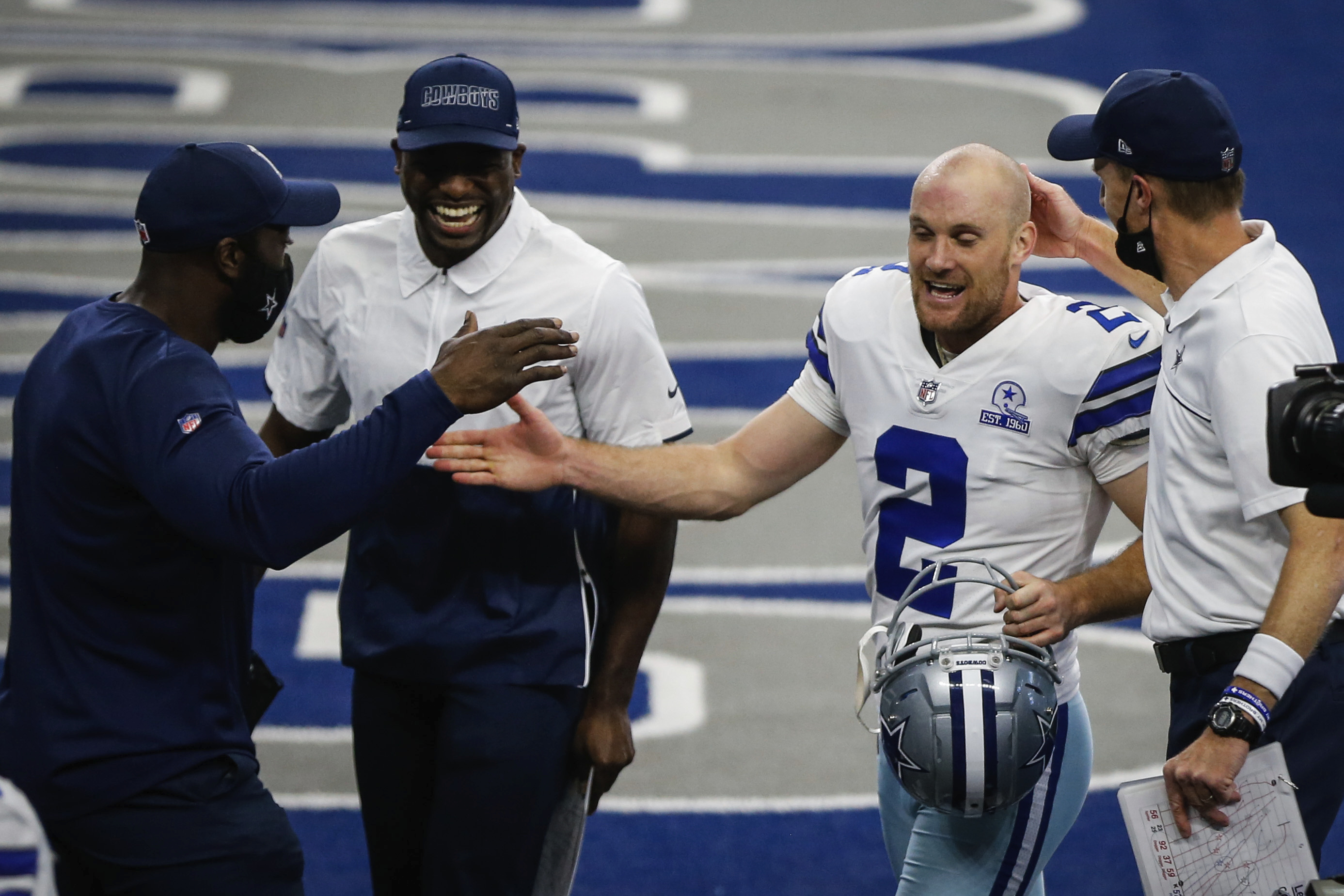 Dallas Cowboys kicker Greg Zuerlein is congratulated as he walks off the field kicking the game-winning field goal against the Atlanta Falcons during an NFL football game Sunday, Sept. 20, 2020, in Arlington, Texas. (Yffy Yossifor/Star-Telegram via AP)