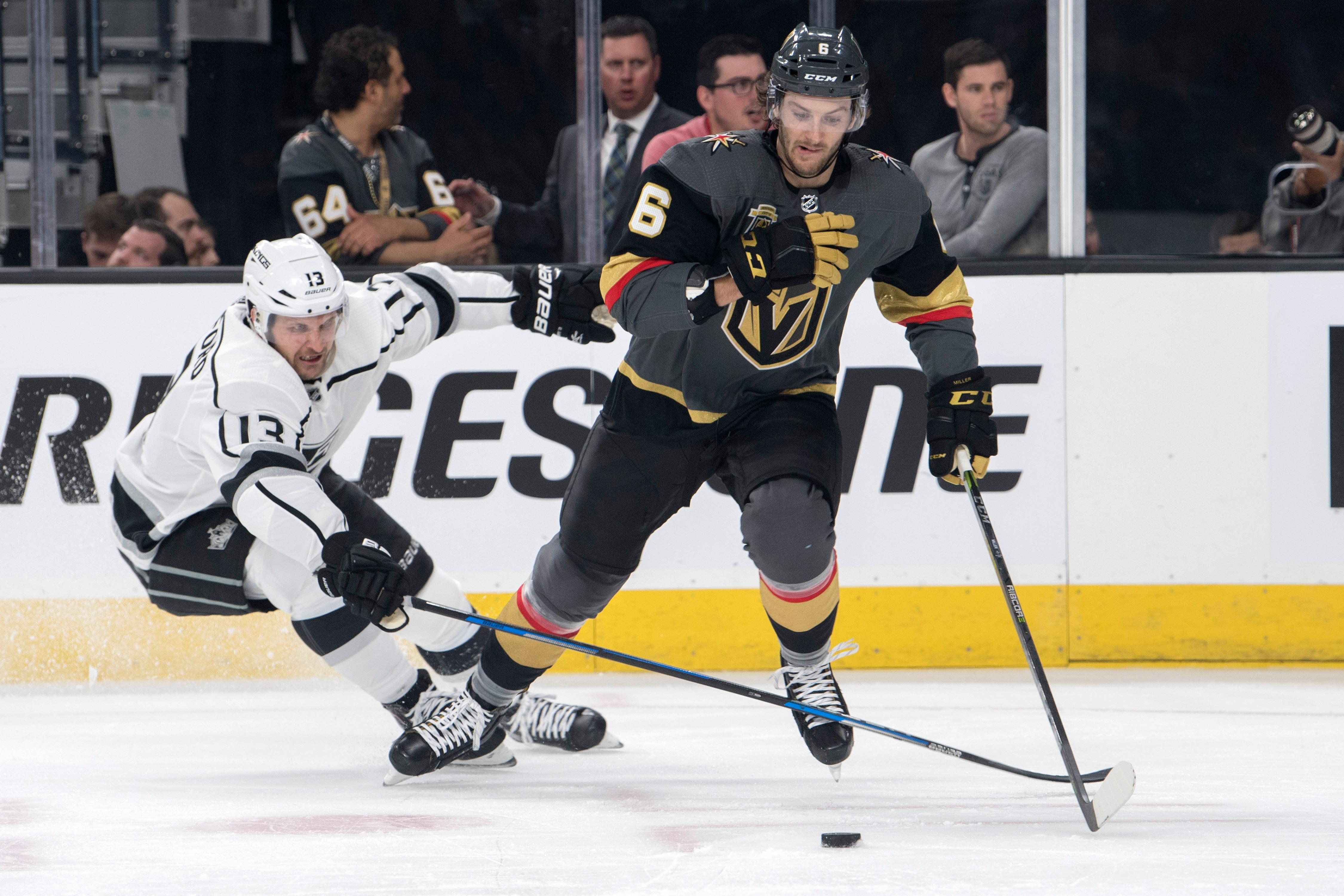 Los Angeles Kings left wing Kyle Clifford (13) and Vegas Golden Knights defenseman Colin Miller (6) chase a down the puck during the first period of Game 1 of their NHL hockey first-round playoff series Wednesday, April 11, 2018 at T-Mobile Arena. The Knights won 1-0. CREDIT: Sam Morris/Las Vegas News Bureau