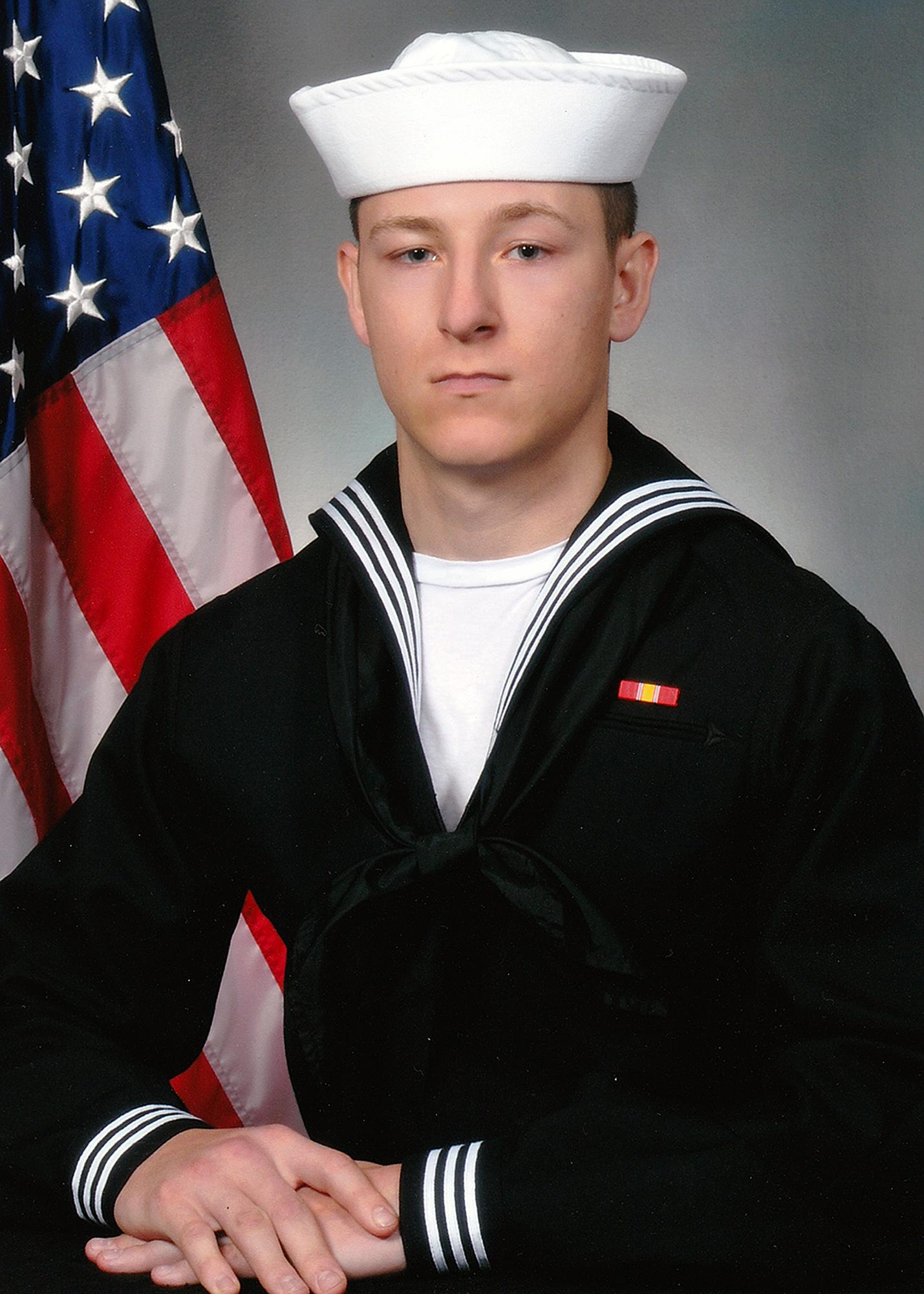 In this undated photo released by the U.S. Navy shows Electronics Technician 3rd Class Kenneth Aaron Smith from Cherry Hill, N.J. Smith, 22, was stationed aboard USS John S. McCain when it collided with an oil tanker near Singapore on Monday, Aug. 21, 2017.  His body was recovered on Aug. 24.  (U.S. Navy via AP)
