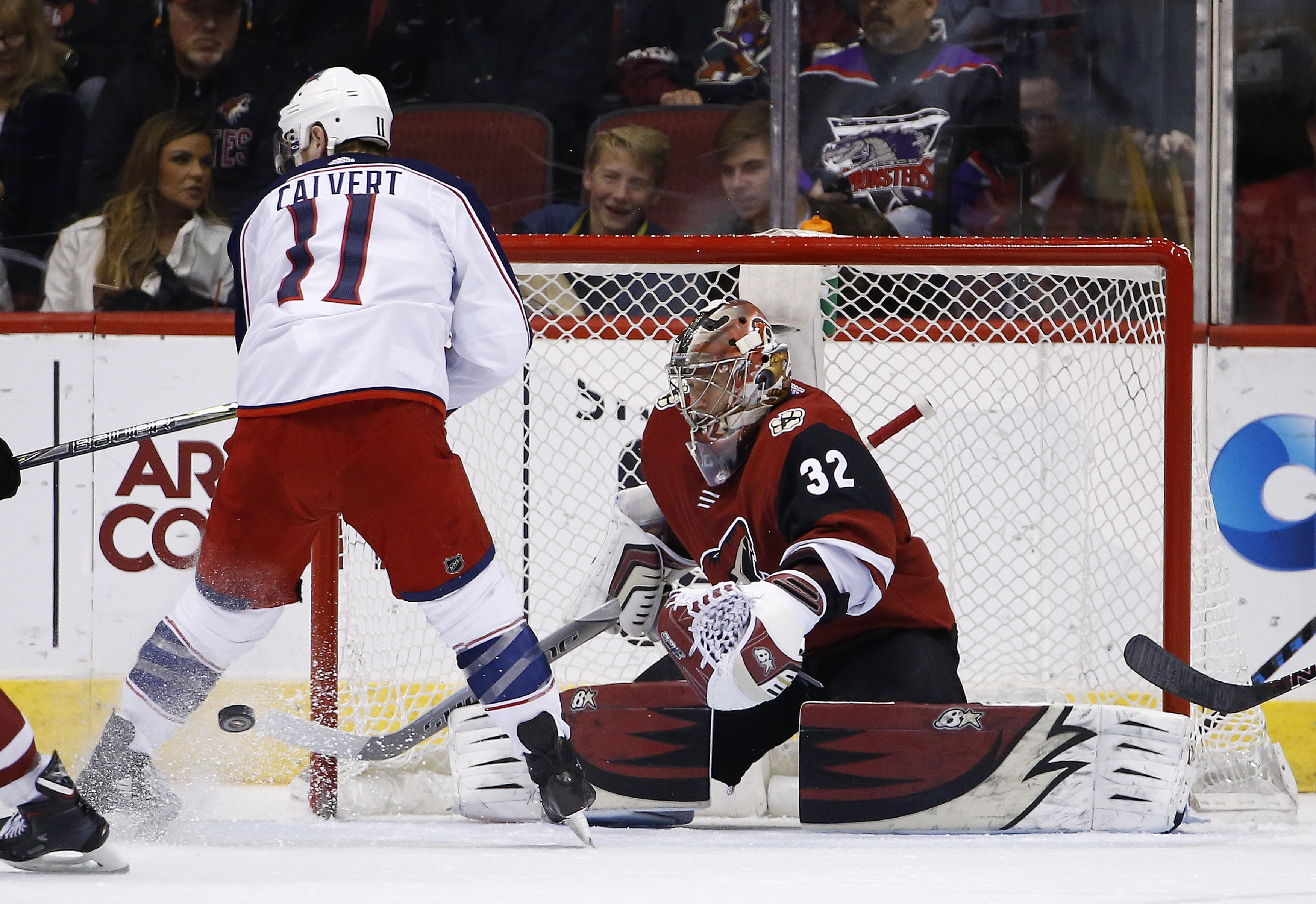 Arizona Coyotes goaltender Antti Raanta (32) makes a save on a shot by Columbus Blue Jackets left wing Matt Calvert (11) during the second period of an NHL hockey game, Thursday, Jan. 25, 2018, in Glendale, Ariz. (AP Photo/Ross D. Franklin)
