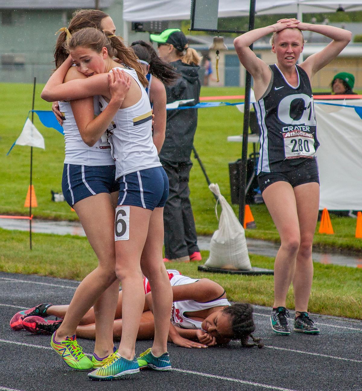 Runners celebrate after running the Women's 1500 Meters event at the 5A-3 Midwestern League District Track Championship. Photo by Vannie Cooper, Oregon News Lab