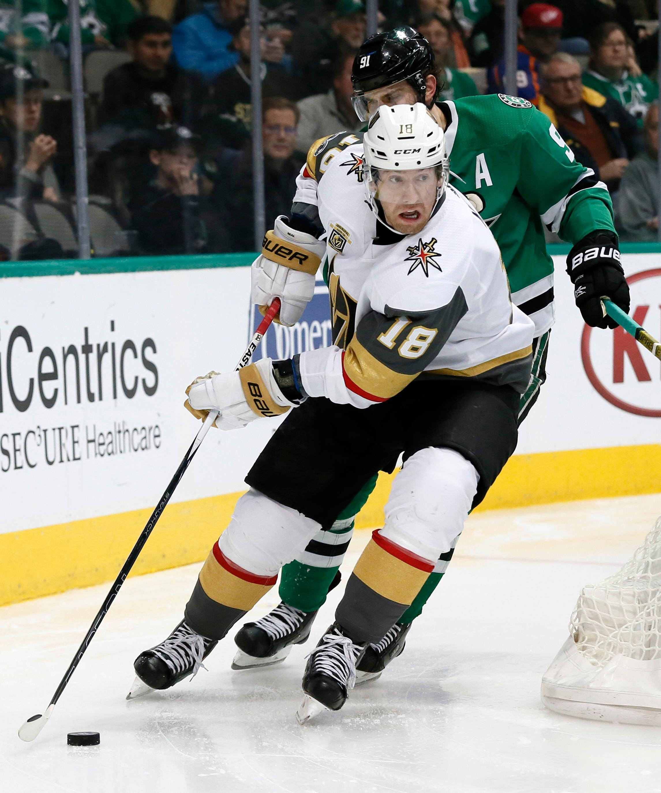 Vegas Golden Knights left wing James Neal (18) handles the puck as Dallas Stars center Tyler Seguin gives chase during the second period of an NHL hockey game, Saturday, Dec. 9, 2017, in Dallas . (AP Photo/Tony Gutierrez)