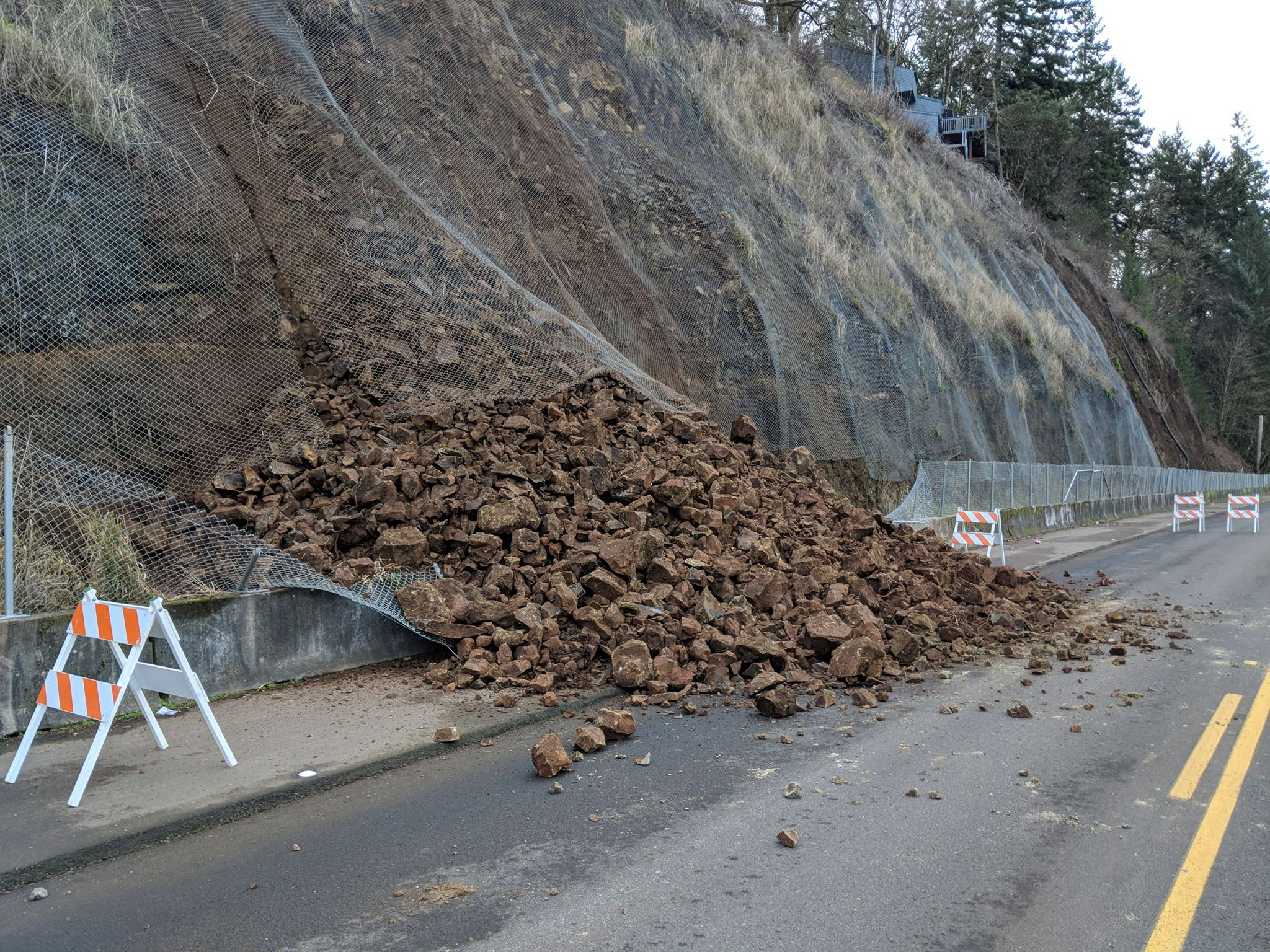 Rock slide on River Road South - Photos from the City of Salem