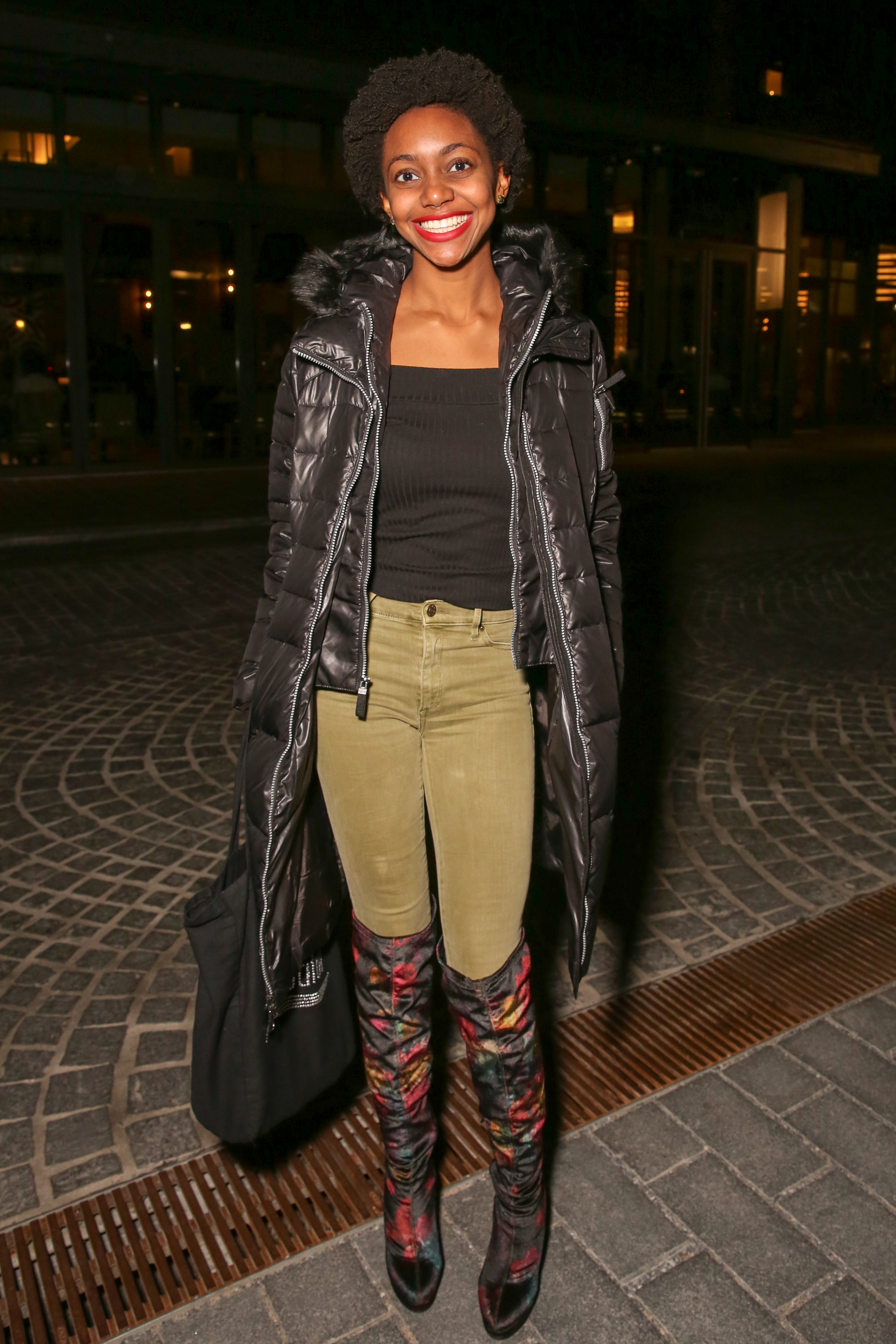 The debate is over - puffy jackets are fashionable, especially with Kayla Williams' over-the-knee boots.{&nbsp;}(Amanda Andrade-Rhoades/DC Refined)<p></p>