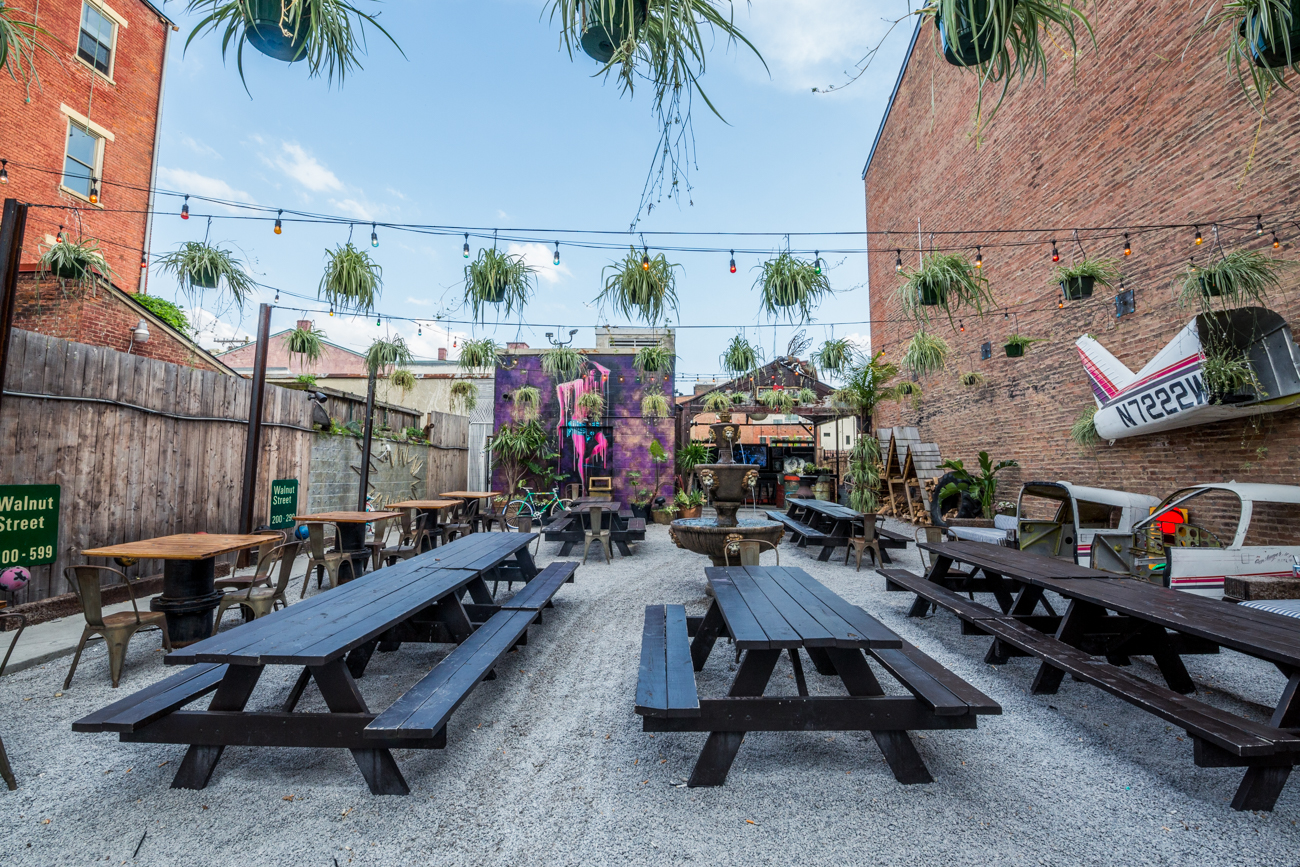 PLACE: Mecca / ADDRESS: 1429 Walnut Street (45202) / In addition to a healthy selection of adult drinks, Mecca's spacious patio in Over-the-Rhine is also extremely photogenic; it's decked out in murals, greenery, and neon lights to take every photo with friends up a notch. / Image: Catherine Viox // Published: 7.7.19