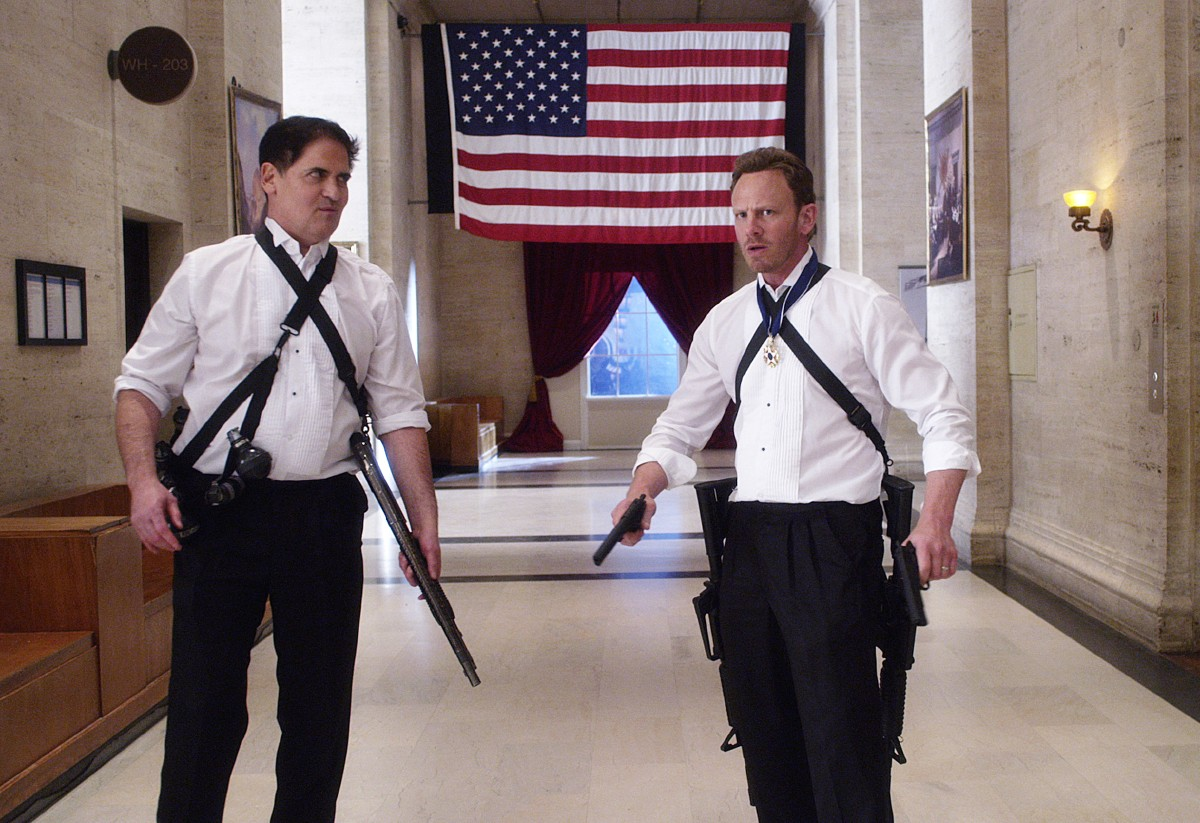 "In this image released by Syfy, Mark Cuban portrays the president, left, and Ian Ziering portrays Fin Shepard in a scene from ""Sharknado 3: Oh Hell No!"" premiering on Wednesday, at 9 p.m. EDT on Syfy.  (Syfy via AP)"