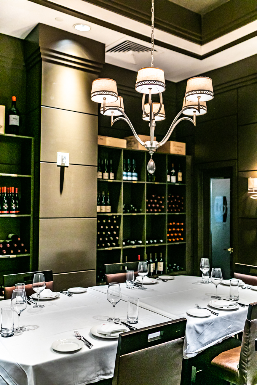A private dining room is available for up to twelve guests. The private dining room is the wine reserve room and contains reds from all over the world. / Image: Amy Elisabeth Spasoff // Published: 12.30.18