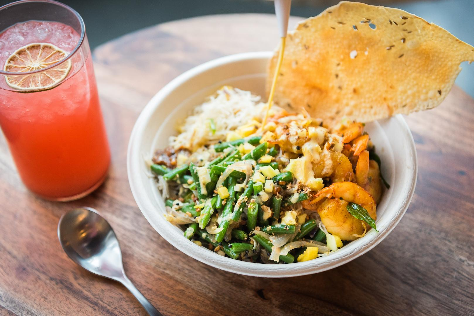 "The menu here is diverse, reflecting the range of ingredients found across India. Guests can build their own bowl, or pick the safety of one of Rasa's signature combinations like the ""Aloo Need Is Love"" or the ""Open Sesame.""{ } (Image: Rey Lopez)"