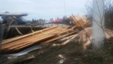 Truck hauling lumber overturns, blocks I-5 exit to I-105
