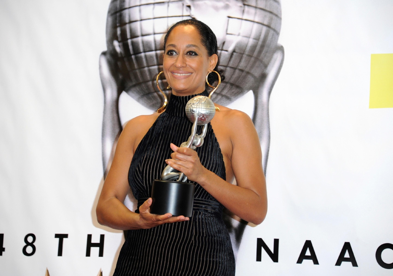 "Tracee Ellis Ross poses in the pressroom with the award for outstanding actress in a comedy series for ""Black-ish"" at the 48th annual NAACP Image Awards at the Pasadena Civic Auditorium on Saturday, Feb. 11, 2017, in Pasadena, Calif. (Photo by Richard Shotwell/Invision/AP)"