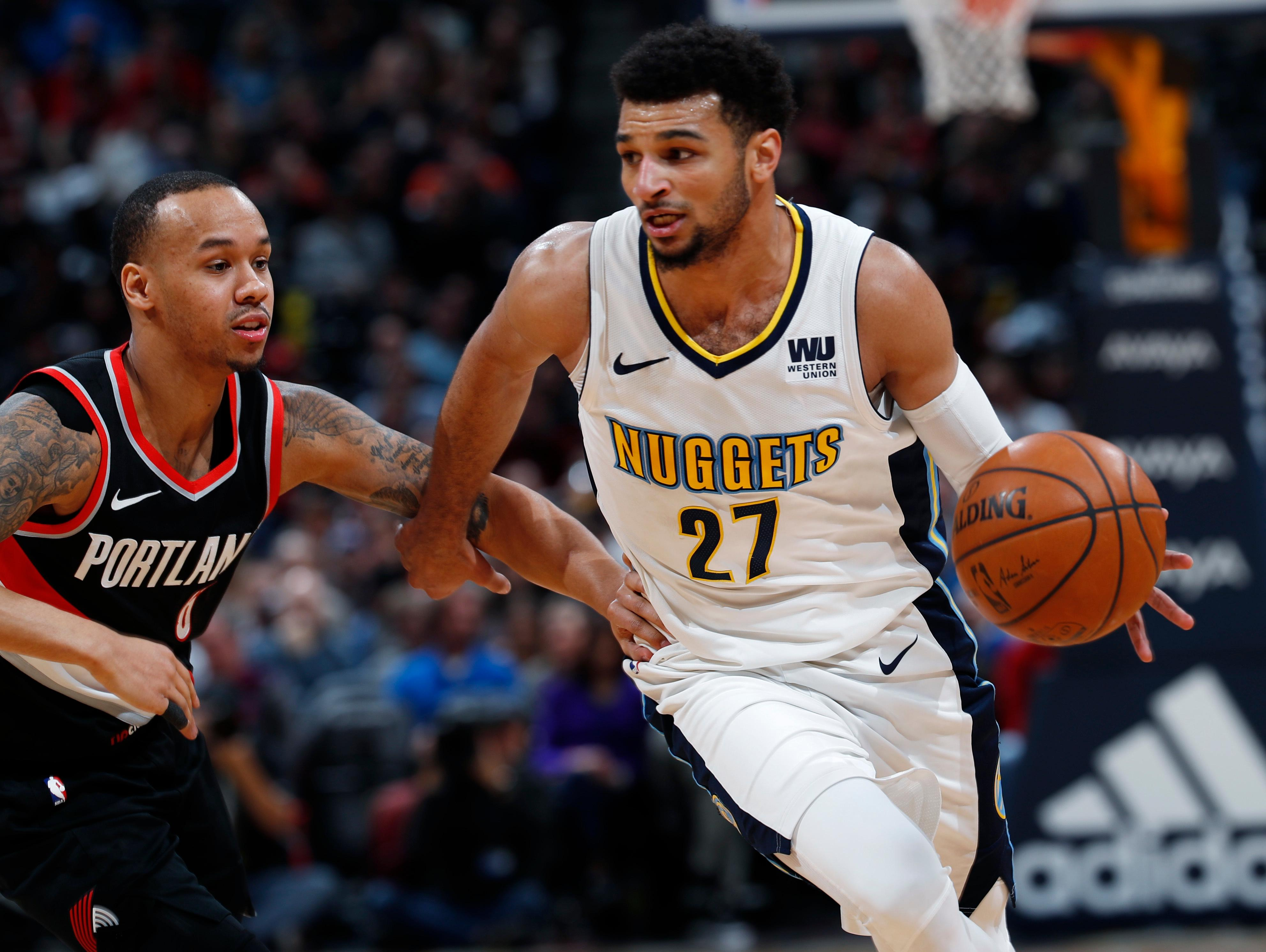 Portland Trail Blazers guard Shabazz Napier, left, defends as Denver Nuggets guard Jamal Murray drives the lane to the rim in the first half of an NBA basketball game Monday, Jan. 22, 2018, in Denver. (AP Photo/David Zalubowski)