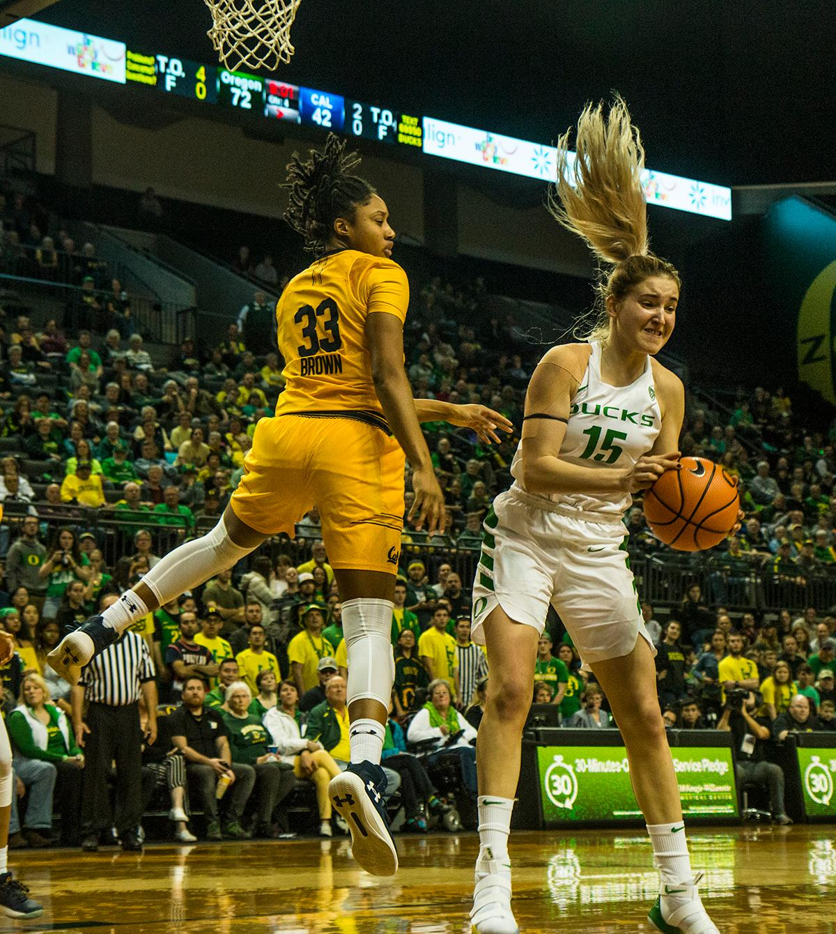 Oregon Ducks Anneli Maley (#15) comes down with a rebound away from Cal Bears Jaelyn Brown (#33). The Oregon Ducks women's team defeated the Cal Golden Bears 91-54 in Matthew Knight Arena Saturday evening. The Ducks had 3 players in double digits: Sabrina Ionescu with 28 points; Ruthy Hebard with 18 points; and Satou Sabally with 10 points. The Ducks now stand at 10-1 in conference play and Cal drops to 6-5. Photo by Kezia Setyawan, Oregon News Lab