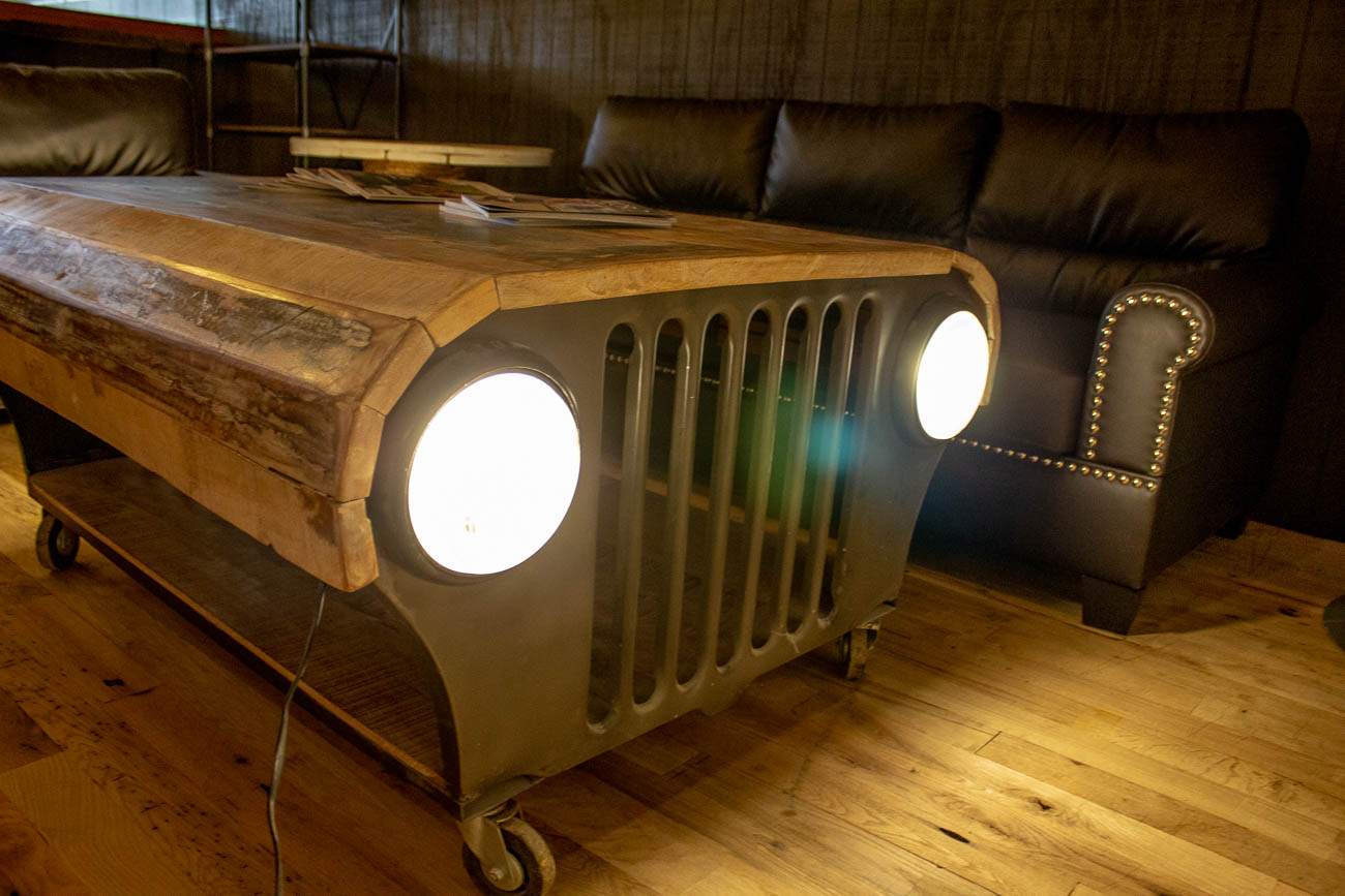 What was once the front of a Jeep, is now a super cool coffee table/light fixture. / Image: Katie Robinson, Cincinnati Refined // Published: 7.22.19