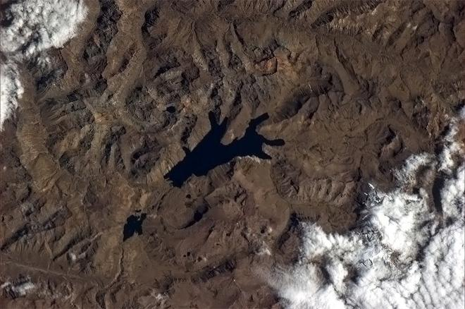 Lake like a shadow puppet.  (Photo & Caption: Col. Chris Hadfield, NASA)