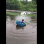 Watch: Boy uses kiddie pool as boat after storm