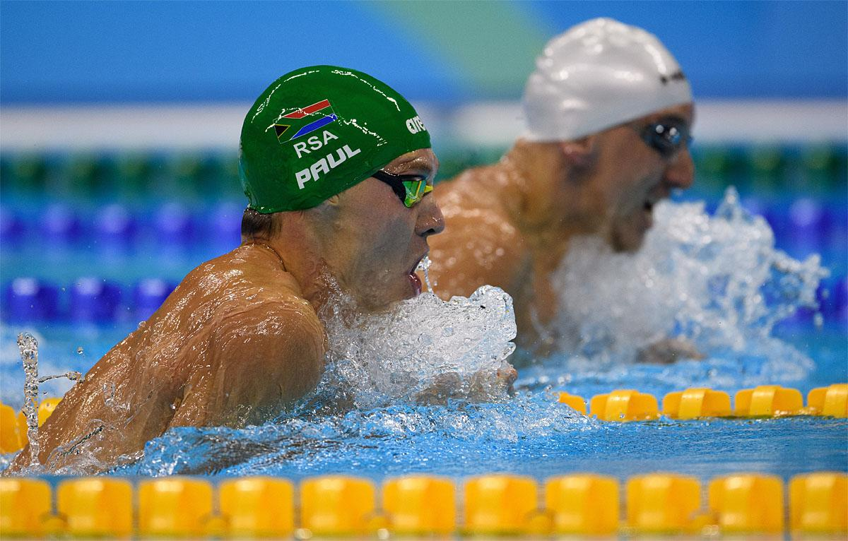In this photo provided by the IOC, South Africa's Kevin Paul, left, swims in to win the men's 100-meter breaststroke - SB9  swimming final of the Paralympic Games in Rio de Janeiro, Brazil, Thursday, Sept. 8, 2016. (Bob Martin/OIS,IOC via AP)