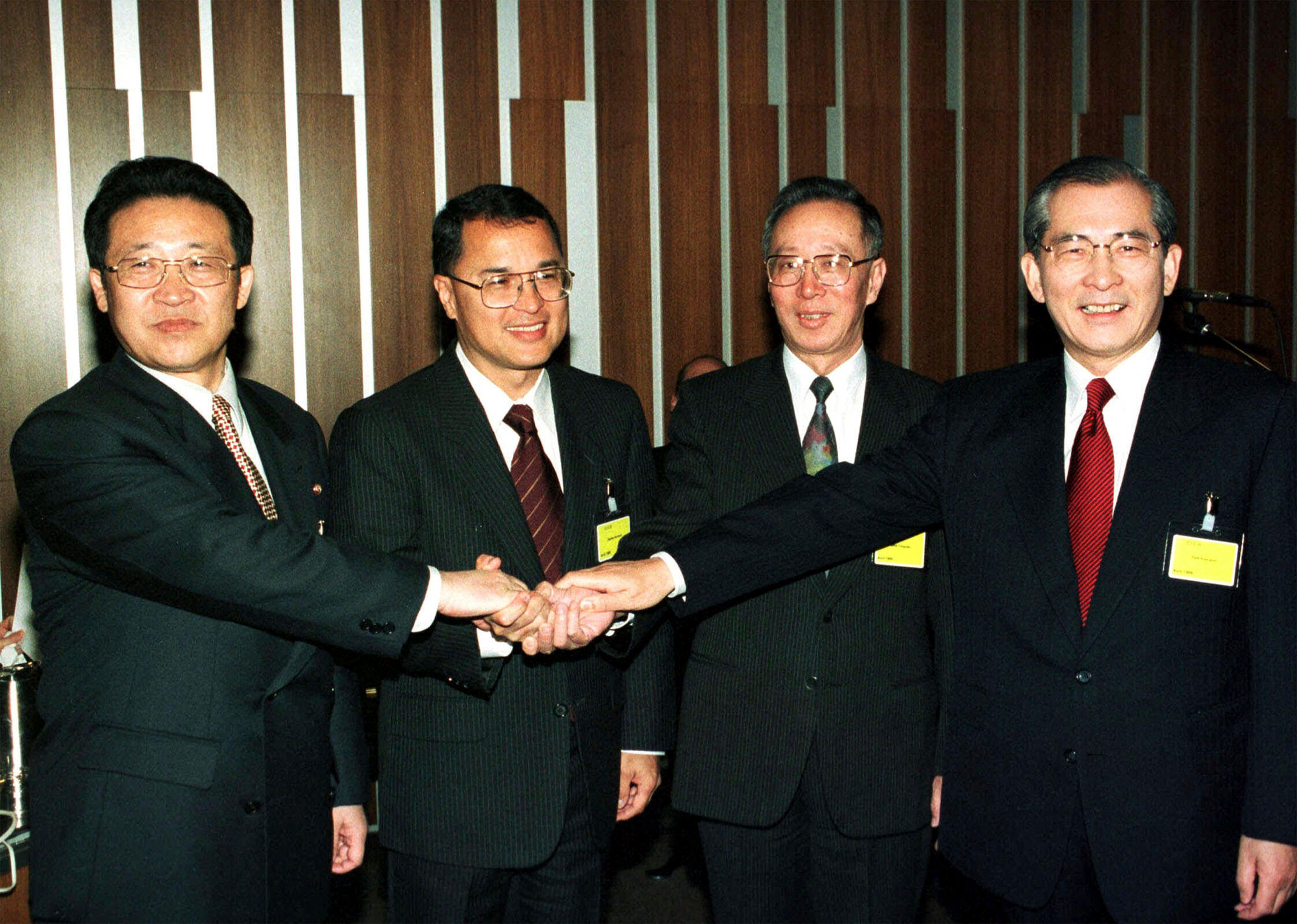 n this April 24, 1999 file photo, delegates of the North and South Korea peace talks join hands before their meeting in Geneva, Switzerland, in this April 24, 1999, file photo. They are from left: North Korean Kim Gye Gwan, American Charles Kartman, China's Qian Yongnian, and South Korean Park Kun-Woo. North Korea has been condemned and sanctioned for its nuclear ambitions, yet has still received food, fuel and other aid from its neighbors and adversaries for decades. How does the small, isolated country keep getting what it wants and needs to prevent its collapse? (AP Photo/Donald Stampfli, File)