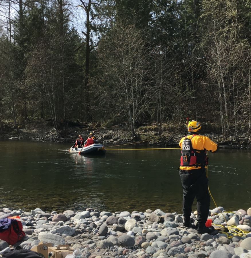 Investigators had to be ferried across the river to investigate a man who was shot to death near Orting on Monday, March 12, 2018, (Photo: Pierce County Sheriff's Department)