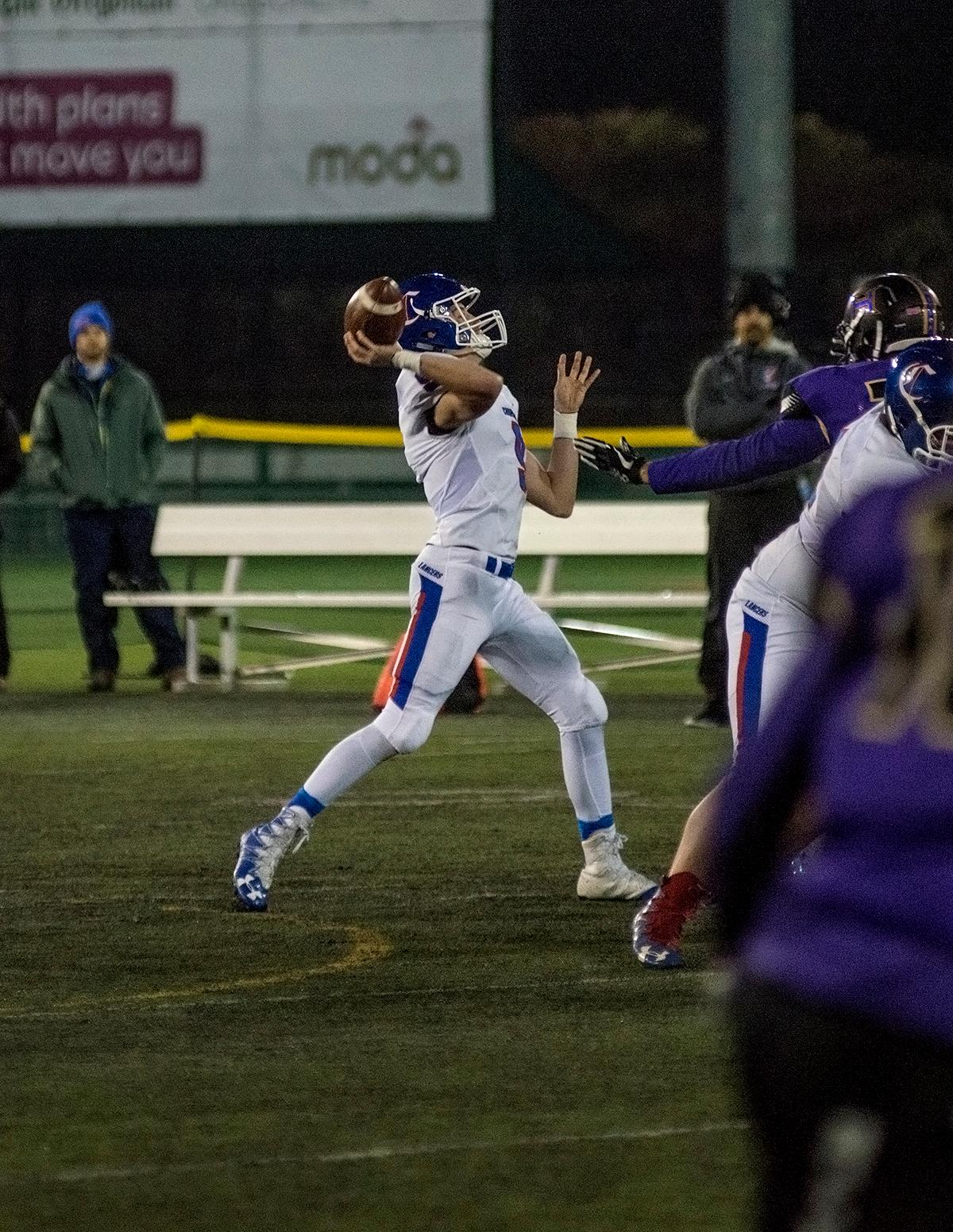 Churchill Lancers wide receiver Luke Walchli (#9) heaves the ball downfield.The Hermiston Bulldogs defeated the Churchill Lancers 38-35 for the 5A state title Saturday evening at Hillsboro Stadium. Photo by Abigail Winn, Oregon News Lab